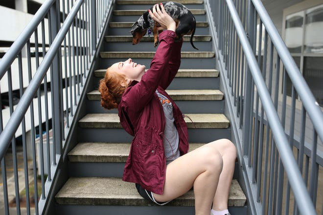 """""""I got a job right out of college and get to go home and be with my family,"""" Haleigh Dellagatti, 22, outside her apartment with her dog Reagan, Sunday, Dec. 9, 2018."""
