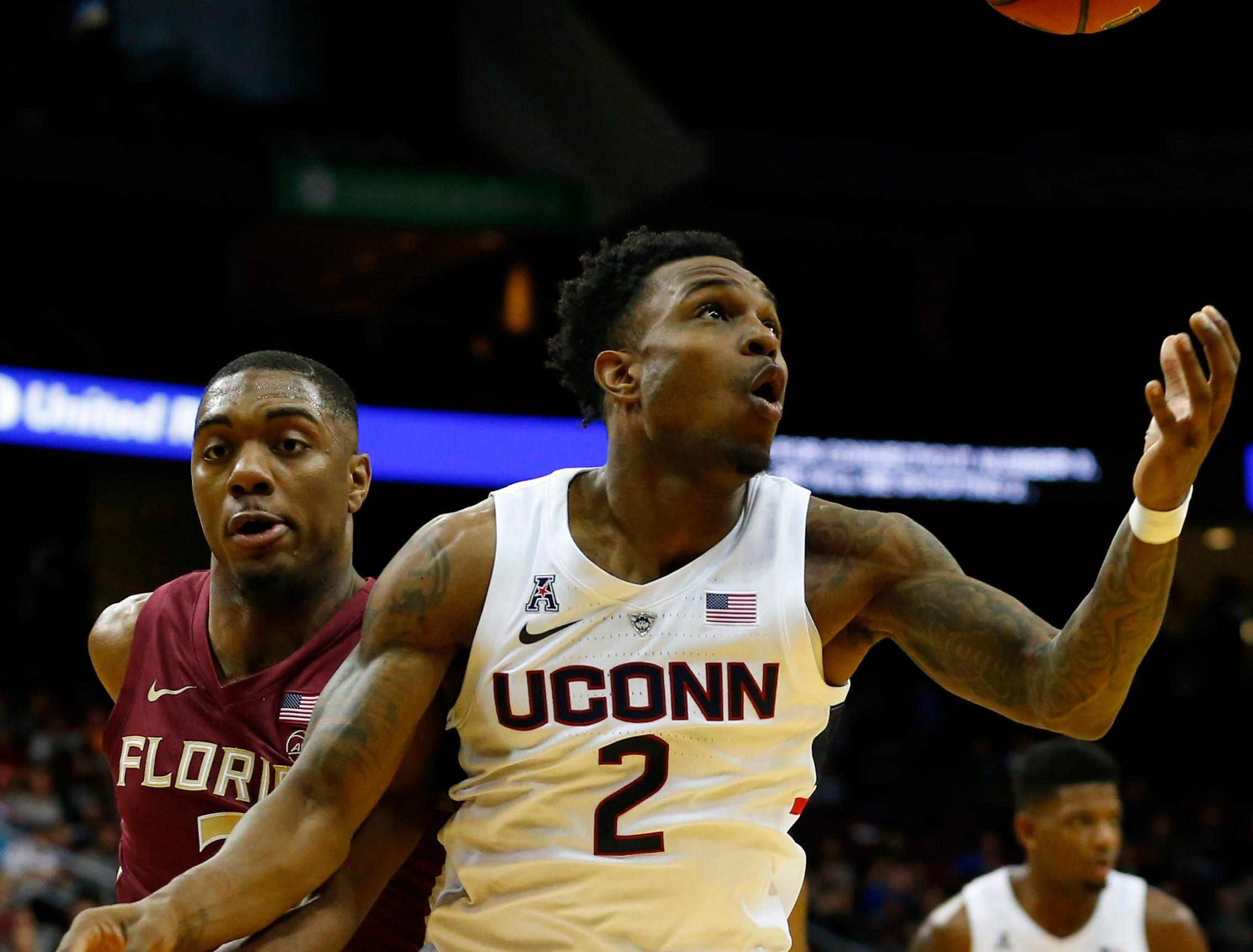 Dec 8, 2018; Newark, NJ, USA; Florida State Seminoles guard Trent Forrest (3) and Connecticut Huskies guard Tarin Smith (2) battle for a rebound during the second half at Prudential Center. Mandatory Credit: Noah K. Murray-USA TODAY Sports