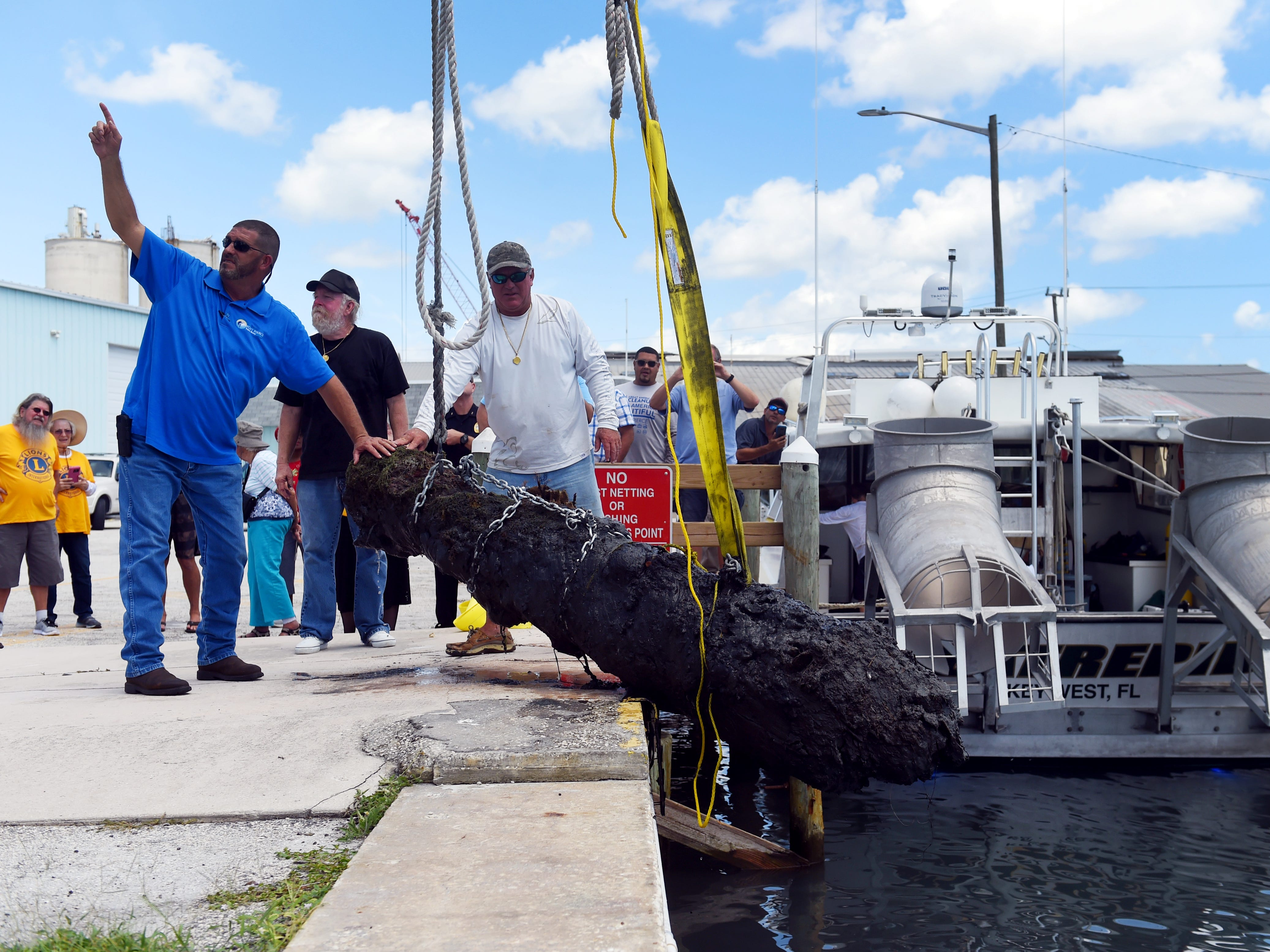 A work crew from the City of Fort Pierce along with members of Maritime Research and Recovery hoist a cannon from the 1715 Spanish Plate Fleet out of the water at Fisherman's Wharf on Monday, Aug. 13, 2018 in Fort Pierce. The recovery of the cannon, discovered in the remains of a shipwreck off Sandy Point, is a collaboration between the Keep Fort Pierce Beautiful Advisory Board and the Fort Pierce Lions Club. The restoration of the cannon will take about three years and will be put on display in the plaza at Melody Lane Fishing Pier.