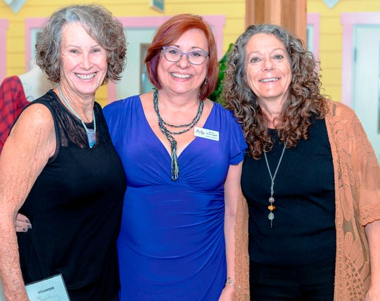 Terri Pettengill, center, mARTies co-chair, with volunteers, Kathy Edwards, left, and Barbara Bucci, right, at the Arts Council of Martin County's annual signature event at the Kane Center in Stuart.