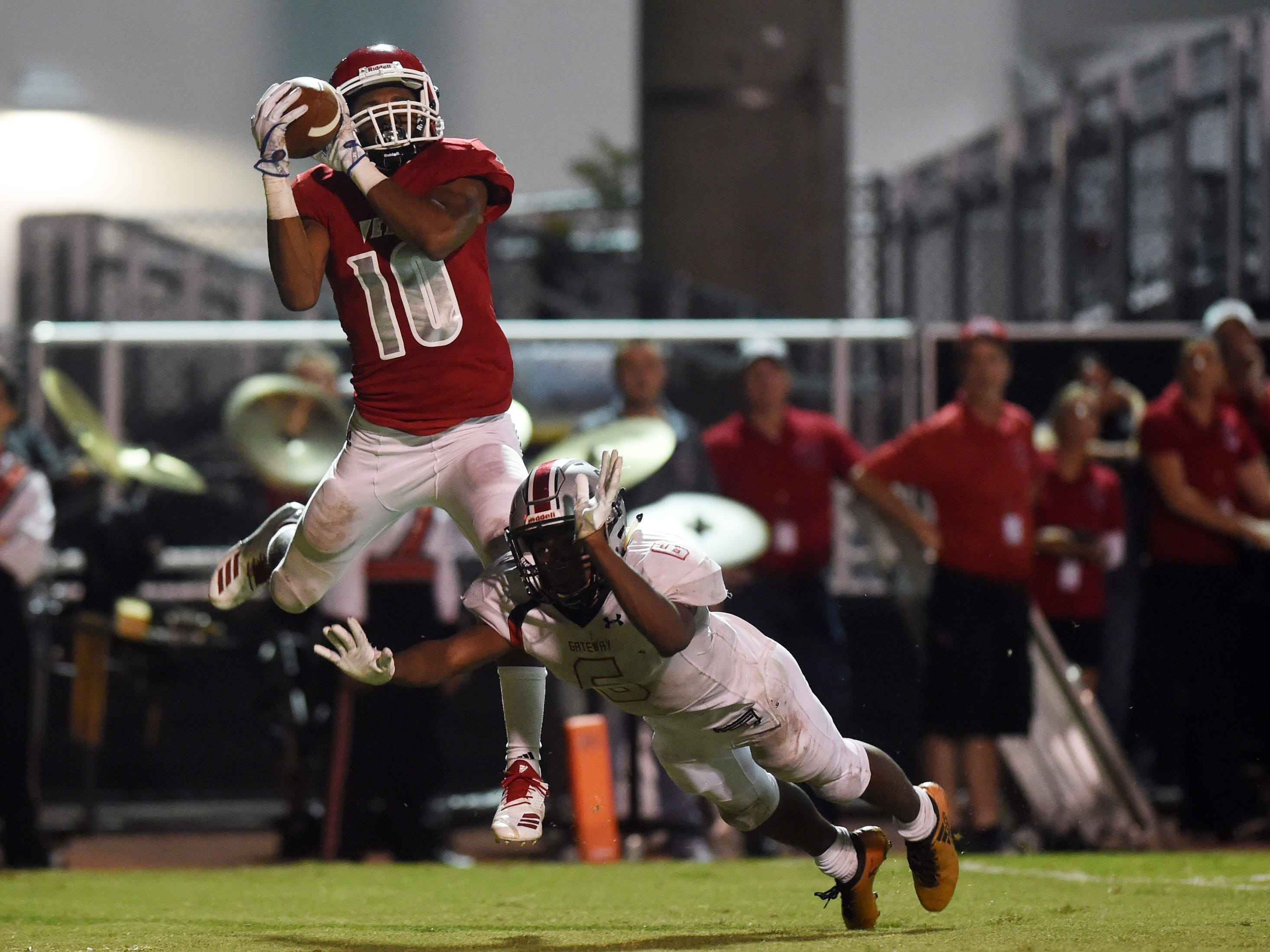 Vero Beach High School's Demarcus Harris hauls in a catch for a touchdown on Friday, Nov. 9, 2018, during a Region 2-8A quarterfinal playoff game against Gateway at the Citrus Bowl in Vero Beach. The fighting Indians won 48-6.