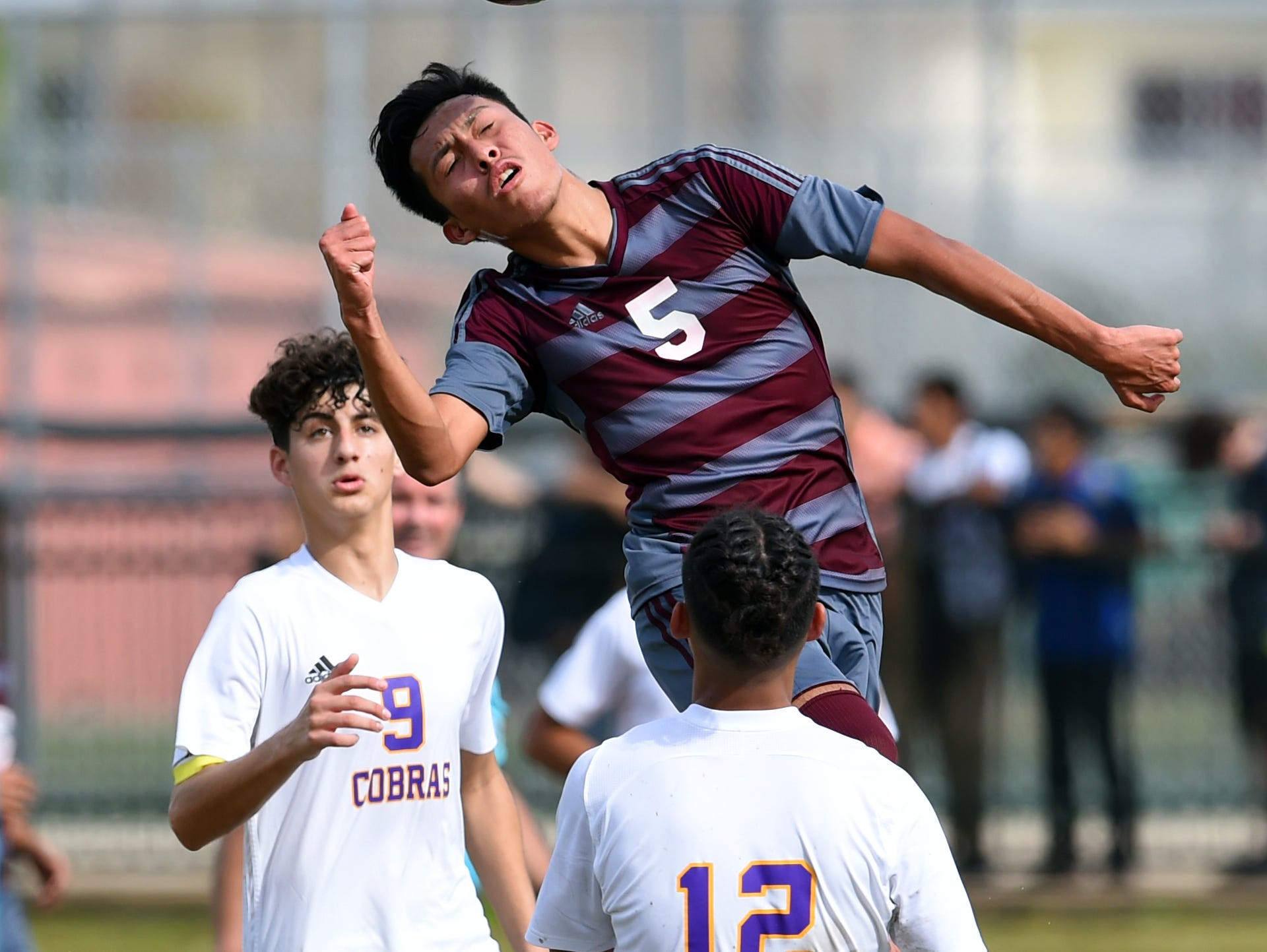 Fort Pierce Westwood High School's Miguel Guadarrama (5) goes up for a header in front of the goal as Fort Pierce Central's Eric Rahman (9) and Kevin Ramos (12) defend Wednesday, Jan. 10, 2018 during a game in Fort Pierce. Westwood won the match 3-1. To see more photos, visit TCPalm.com