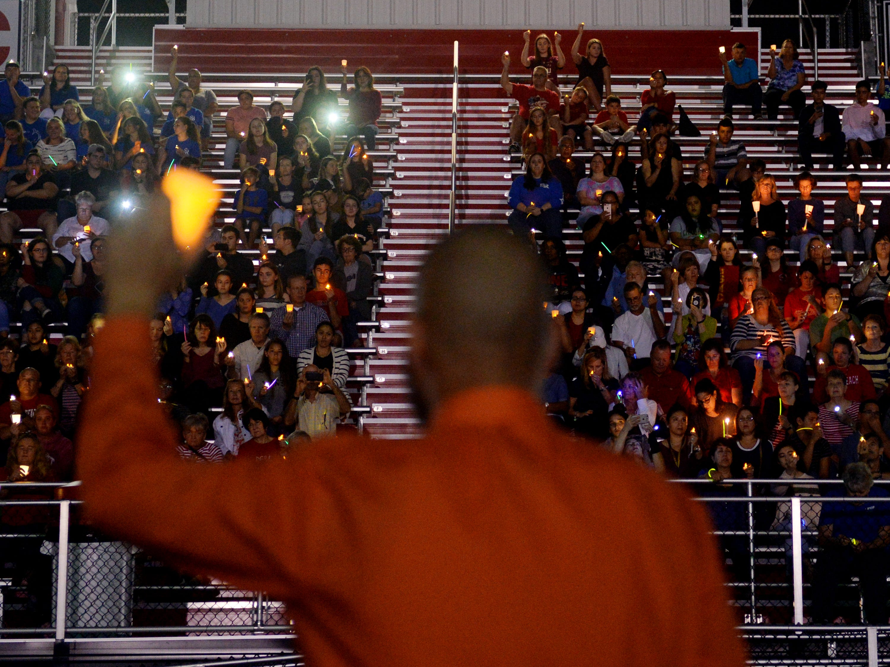 About 300 people gathered Monday, Feb. 19, 2018, at the Citrus Bowl at Vero Beach High School for a candlelight vigil in honor of those who died last week in the Marjory Stoneman Douglas High School shooting in Parkland. The event was organized by the Florida PTA and similar vigils were held in counties across the state. Vigils began promptly at 7 p.m. in 15 counties: Alachua, Broward, Duval, Escambia, Hillsborough, Indian River, Leon, Martin, Miami-Dade, Orange, Palm Beach, Pasco, Pinellas, Seminole and Volusia. Some counties had more than one vigil.