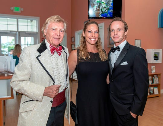 Tom Prestopnik, left, recipient of the Arts Leadership Award, with Susanne and Robby Franklin at the 2018 mARTies Awards.