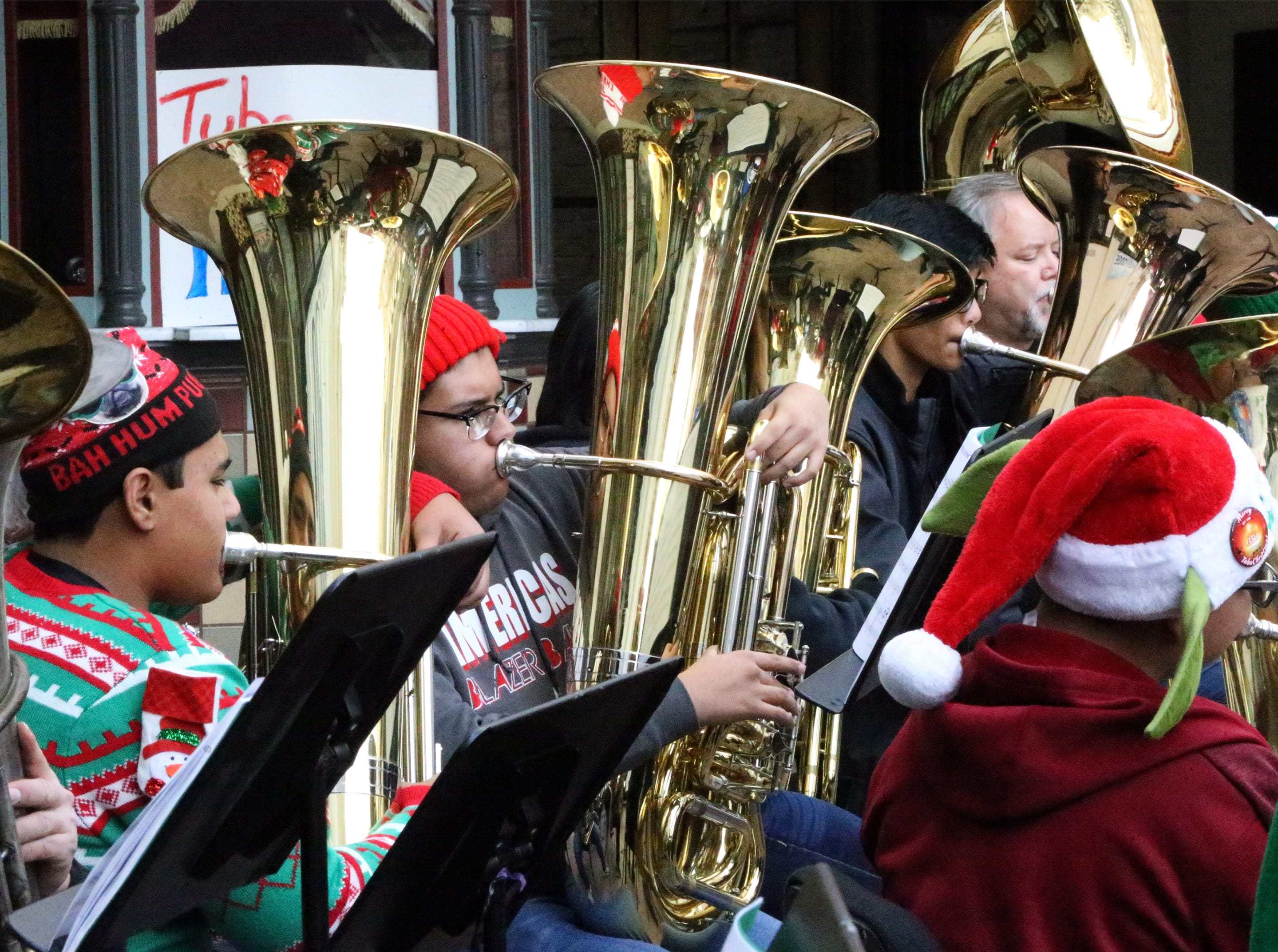 Tuba players play a variety of Christmas favorites during the annual Tuba Christmas concert outside the Plaza Theatre in downtown El Paso Saturday. The event featured just over 40 tuba and baritone horn players who got together, practiced for about an hour before giving the free performance.
