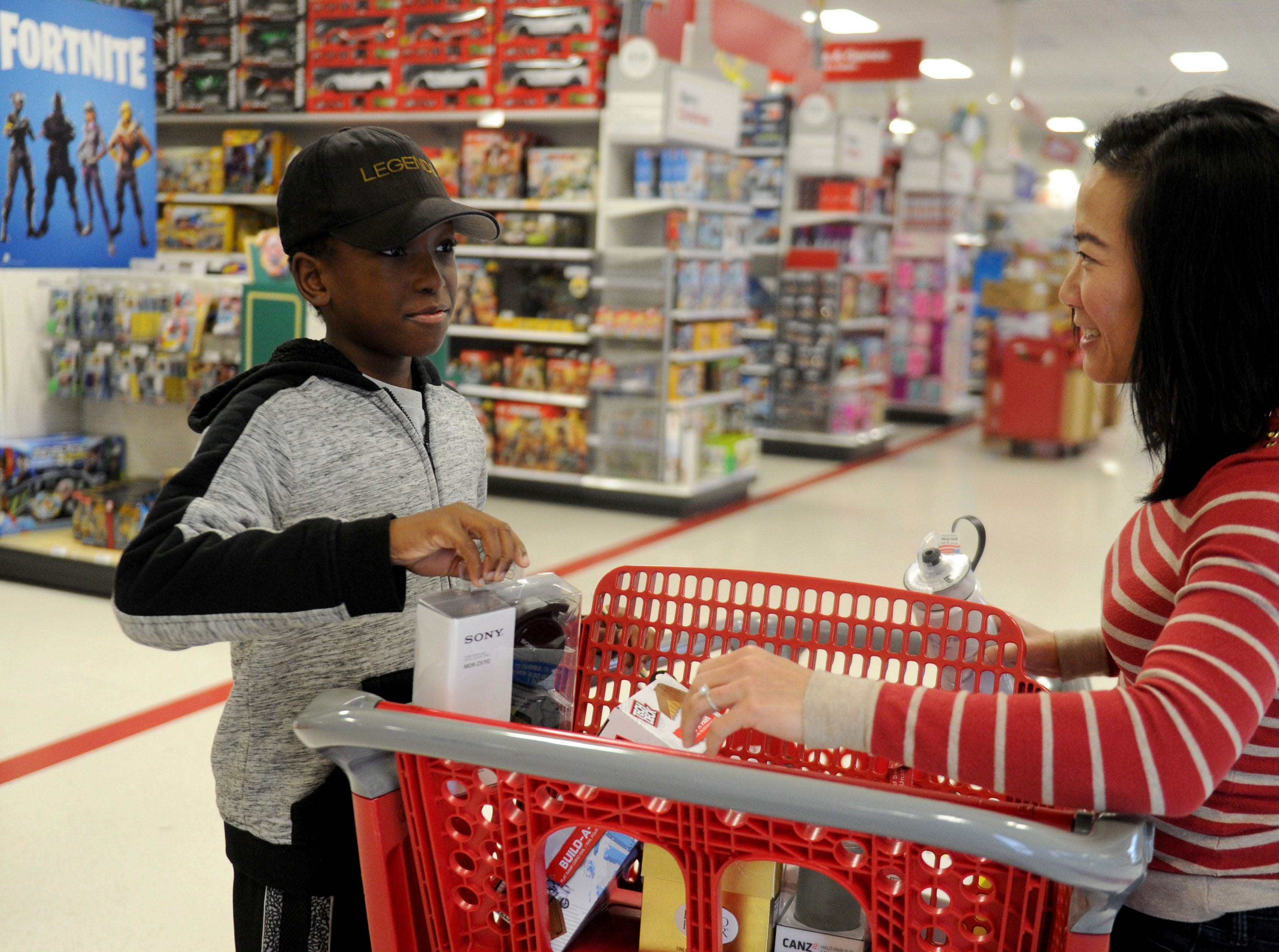 Samuel Opoku gets help from Kristina Tansavatdi, with the Rotary Club of Westlake Village, with picking some toys and a gift for his mom. The club hosted a shopping spree at Target for 36 members of the Boys & Girls Club. The children, each with $110 to spend, were paired with 36 volunteers, and they also got two $10 gift cards so they could buy gifts for someone else.
