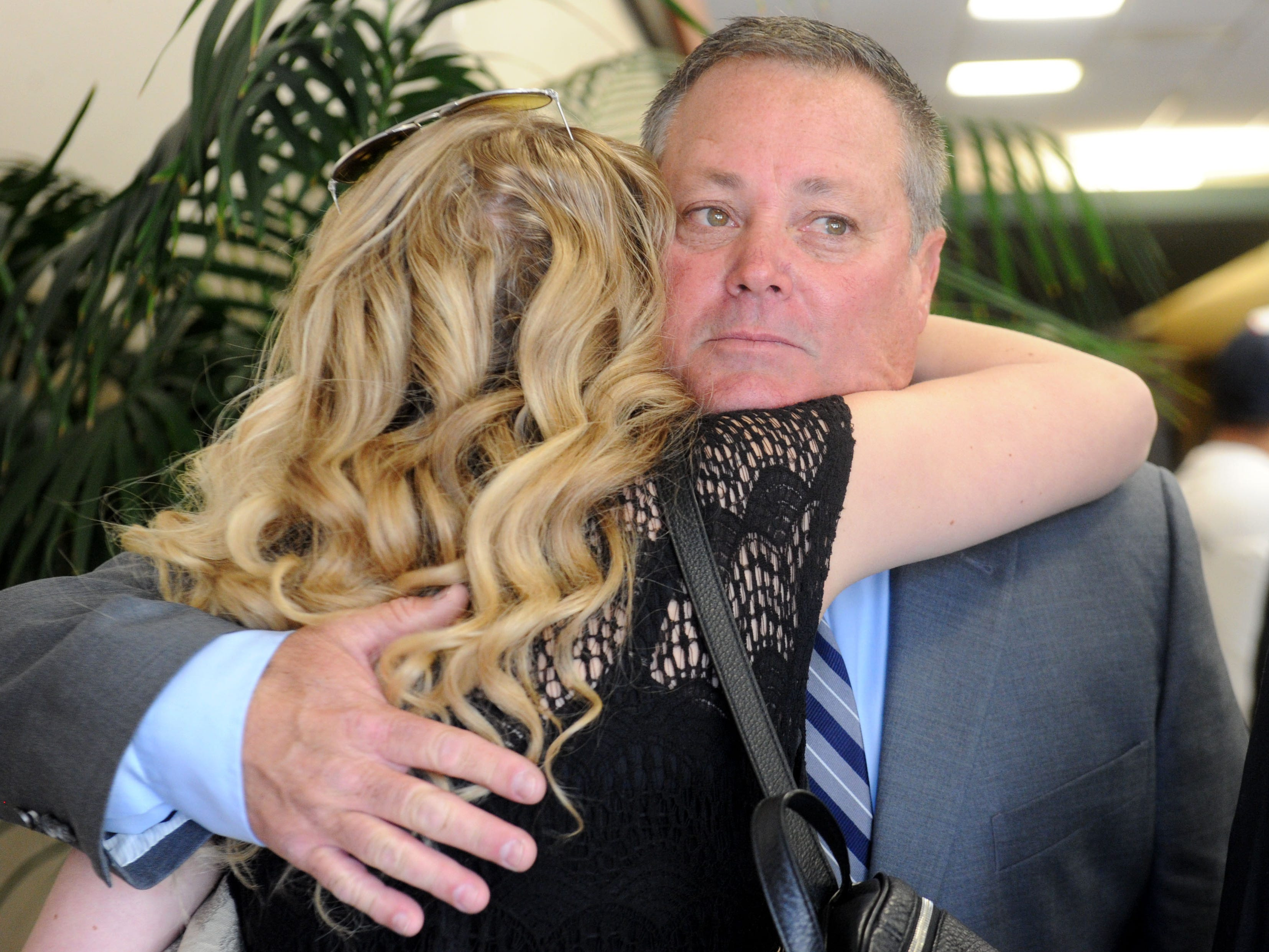 Ken Dunham gets hugs from the friends and family members at the start of the memorial service for his son Jake Dunham, who was killed the night of Nov. 7 at the Borderline Bar & Grill in Thousand Oaks.