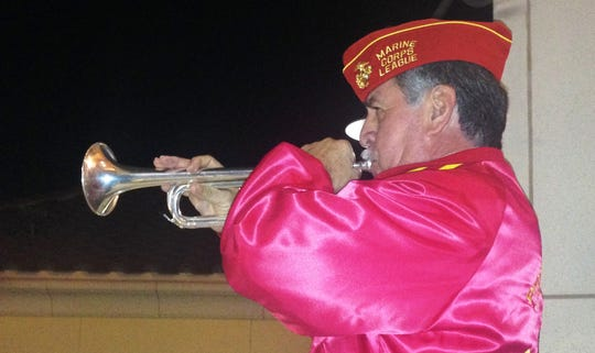Bob Martin, a color guard bugler with President Ronald Reagan Marine Corps League Detachment 597, plays taps at a commemoration of the 77th anniversary of the attack at Pearl Harbor, Hawaii. The event took place at the VFW Museum of Military History in Simi Valley on Dec. 7.