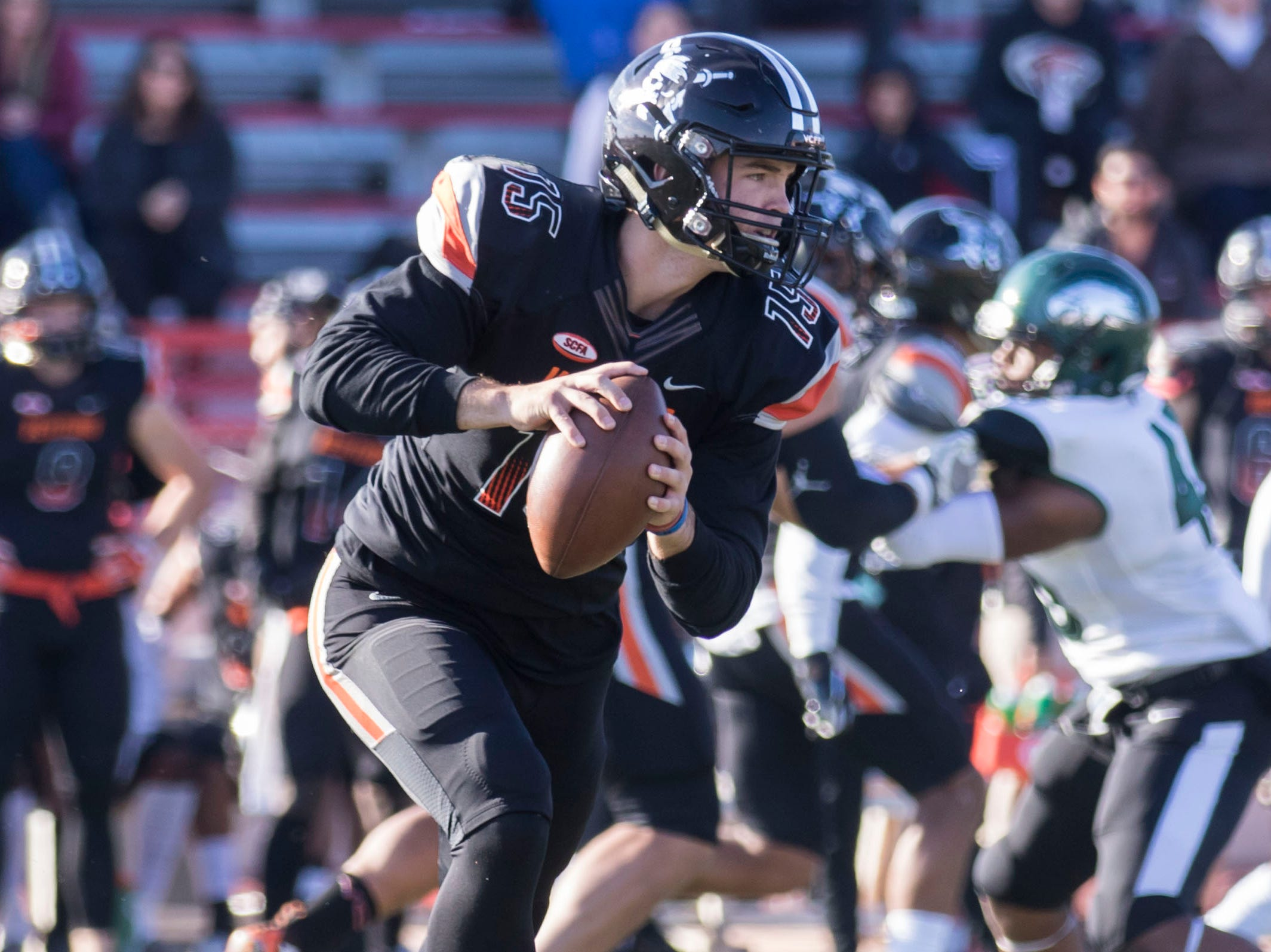 Ventura College quarterback Brock Domann rolls out with the ball during the CCCAA state championship game on Saturday afternoon at Sacramento City's Hughes Stadium. Laney won, 40-35.