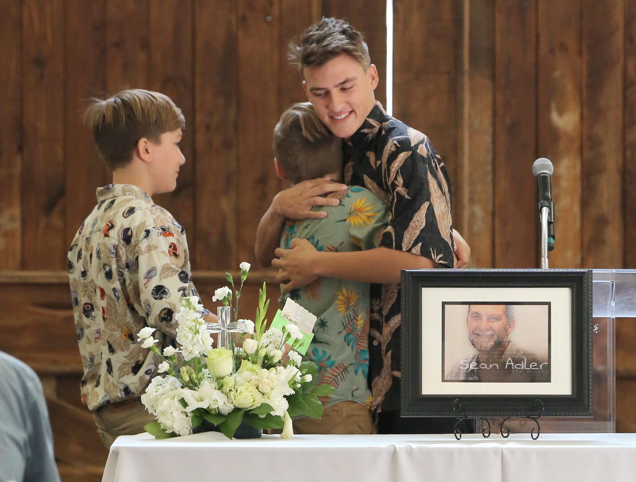 Borderline shooting victim remembered as a family man and a hero at memorial service