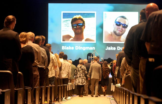 The families of Jake Dunham and Blake Dingman make their way into the  memorial service for the pair on Saturday at Calvary Community Church in Westlake Village. The two were killed the night of Nov. 7 at the Borderline Bar & Grill in Thousand Oaks.