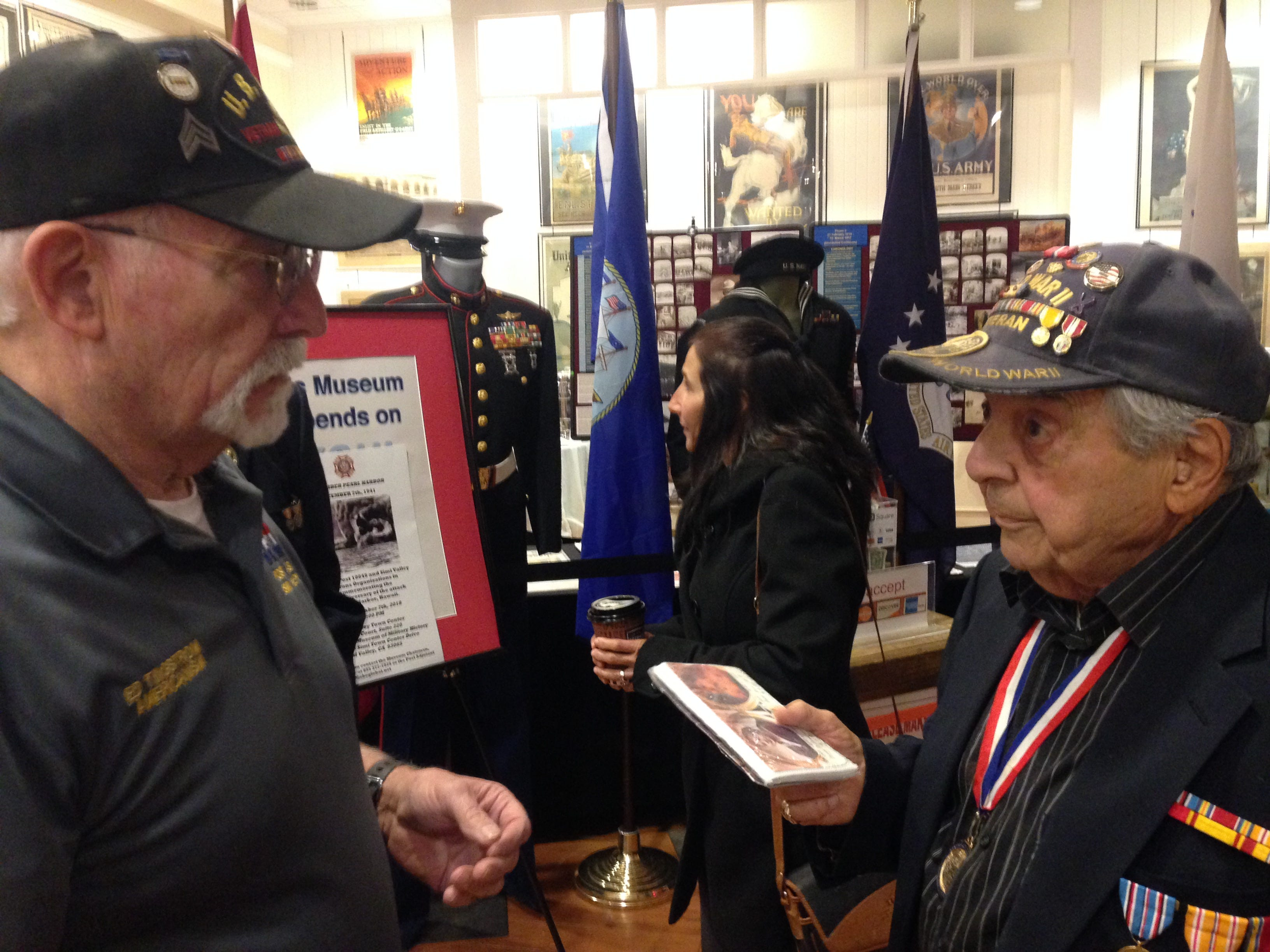 Ed Tingstrom, a United States Army Vietnam combat veteran who is also an educator, published author and military historian, talks with Barney P. Leone, a 94-year-old veteran of World War II. The two men were guest speakers at a commemoration of the 77th anniversary of the attack at Pearl Harbor, Hawaii. The event took place at the VFW Museum of Military History in Simi Valley on Dec. 7.
