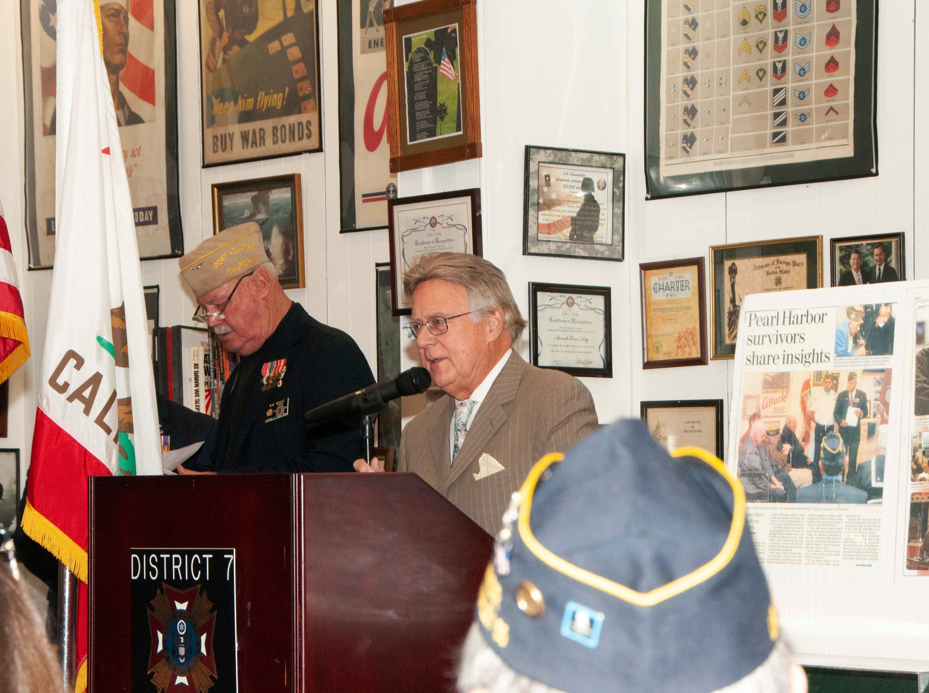 Bob Huber talks to the audience during a commemoration of the 77th anniversary of the attack at Pearl Harbor, Hawaii. The event took place at the VFW Museum of Military History in Simi Valley on Dec. 7. Standing at Huber's left is Wayne Wright, adjutant service officer for VFW Post 10049 in Simi Valley.