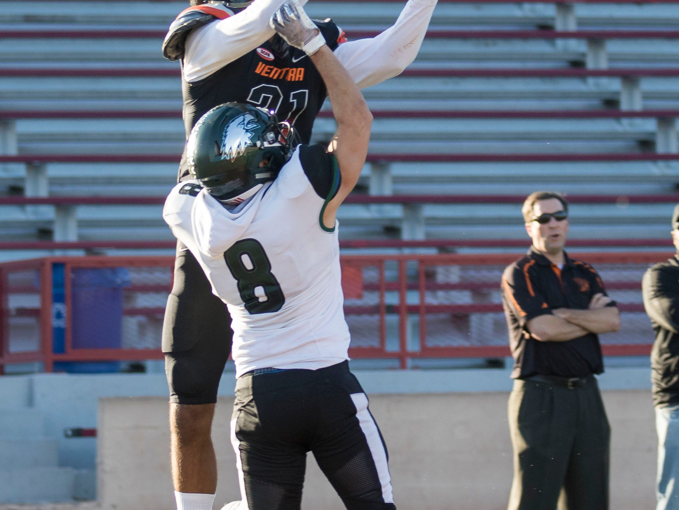 Ventura College sophomore receiver Brandon Jordan rises over Laney College Imani Moore (8) to catch his third touchdown of the day in the CCCAA state championship game on Saturday afternoon at Sacramento City's Hughes Stadium. Laney won, 40-35.