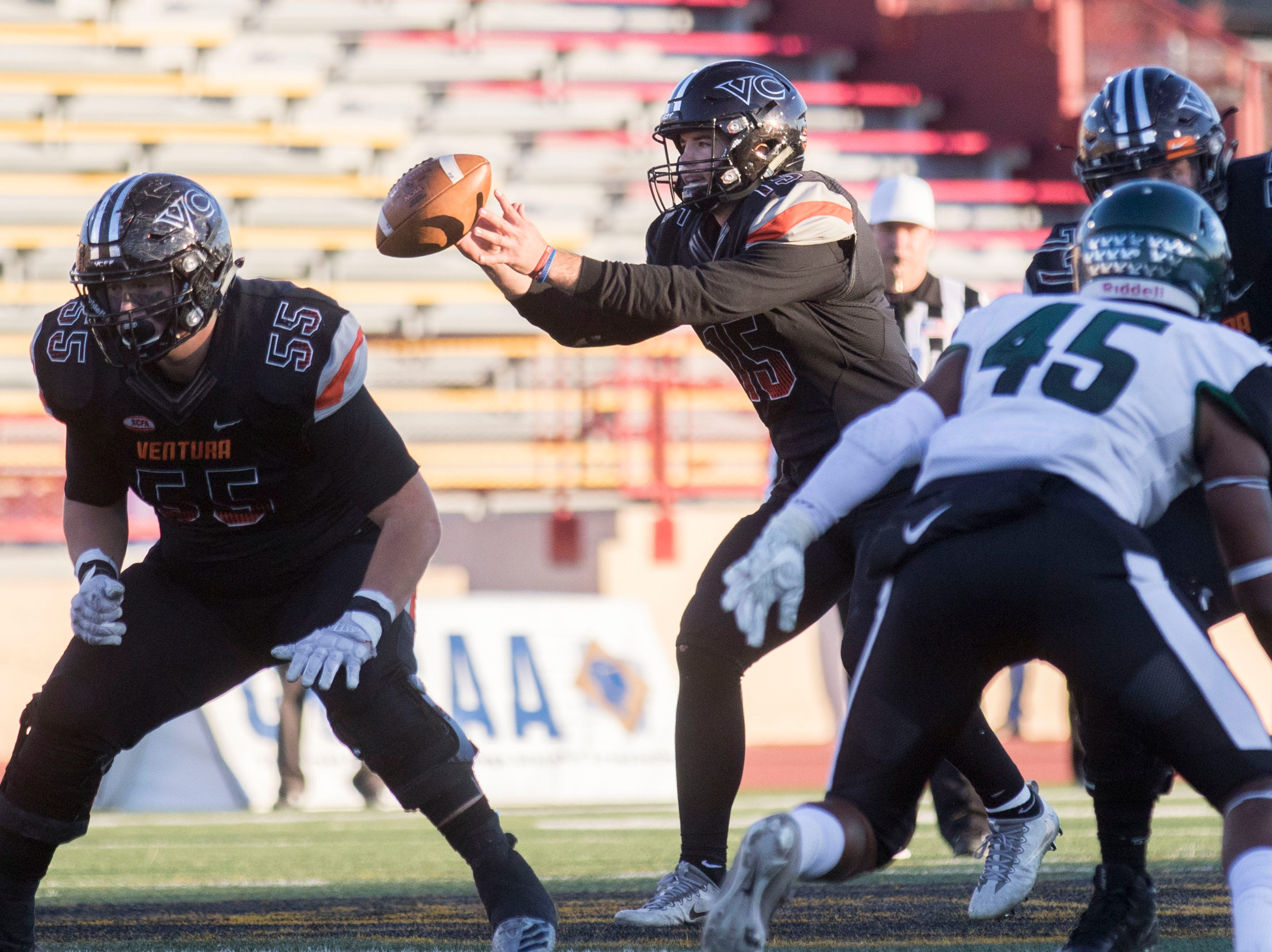Protected by offensive lineman Tyler Orsini, left, Ventura College quarterback Brock Domann takes a snap during the CCCAA state championship game on Saturday afternoon at Sacramento City's Hughes Stadium. Laney won, 40-35.