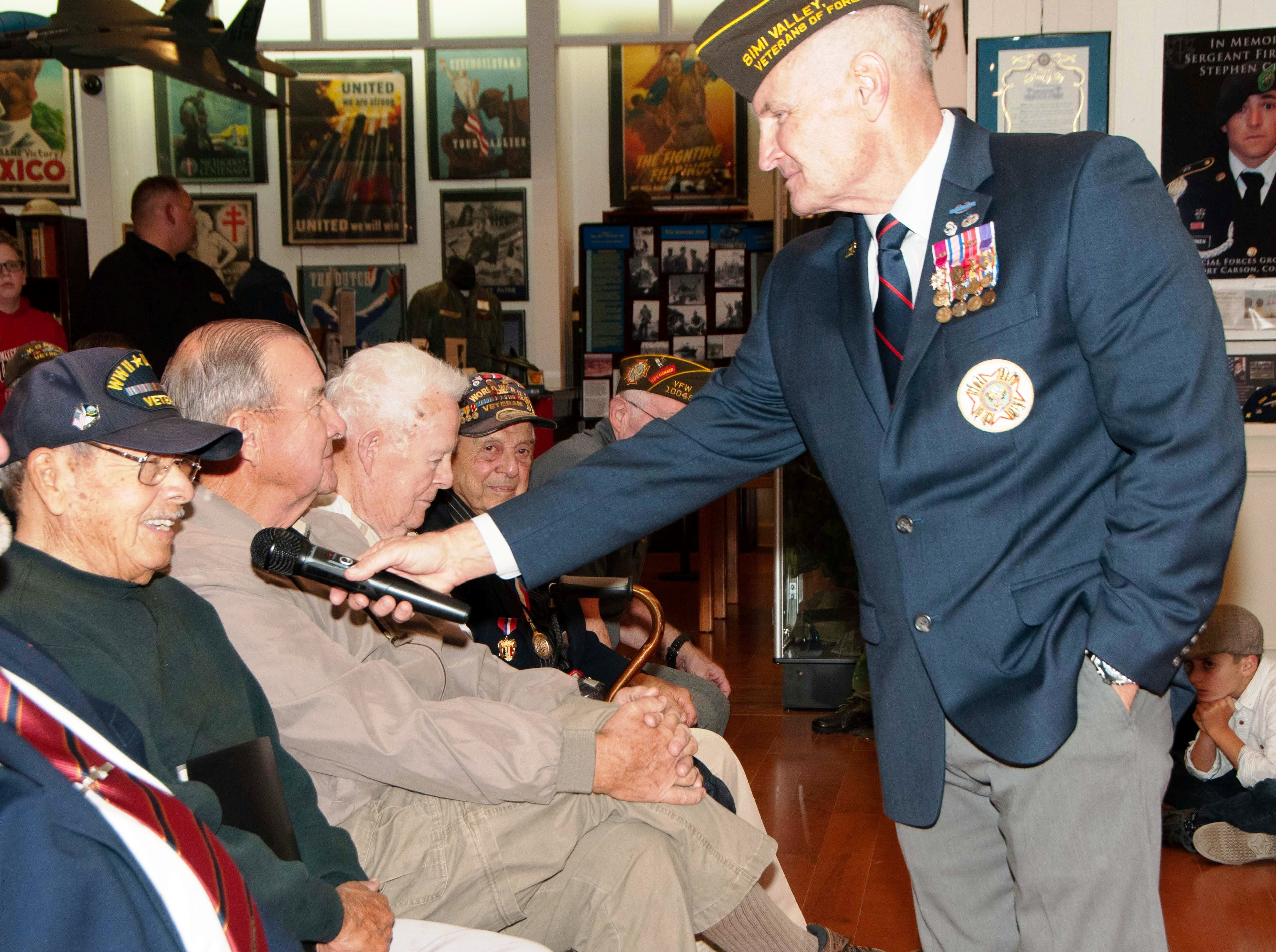 Retired U.S. Army Lt. Col. Martin Spann passes the microphone during a commemoration of the 77th anniversary of the attack at Pearl Harbor, Hawaii. Spann was the emcee for the event which took place at the VFW Museum of Military History in Simi Valley on Dec. 7.