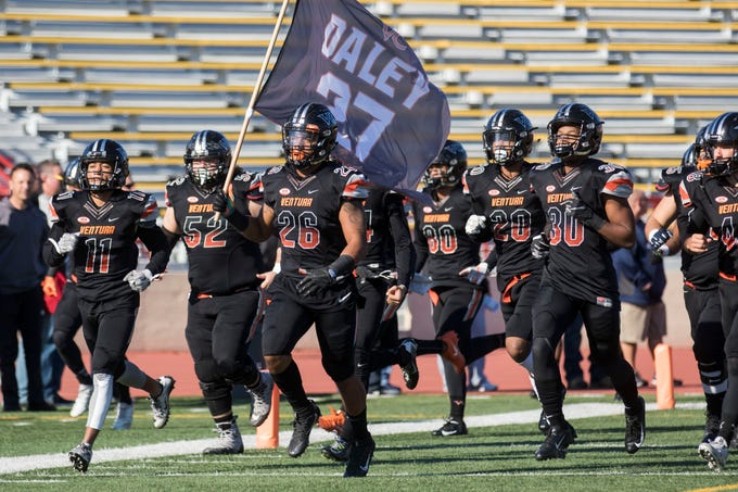 Sophomore Tai Williams (26) and the Ventura College football team honored former linebacker and assistant coach Brenden Daley as they took the field before the CCCAA state championship game on Saturday afternoon at Sacramento City's Hughes Stadium.