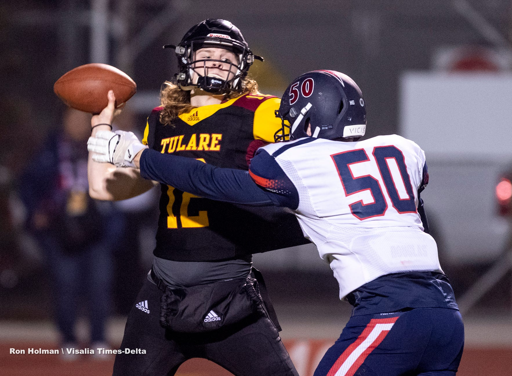 Tulare Union's Nathan Lamb passes under pressure from San Joaquin Memorial's Justin Hunt during a CIF State Northern California Division 2-A Regional Bowl Game at Mathias Stadium on Saturday, December 8, 2018.
