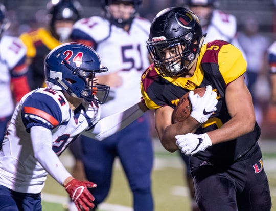 Tulare Union's David Bailey runs into San Joaquin Memorial's Daniel Flores during a CIF State Northern California Division 2-A Regional Bowl Game at Mathias Stadium on Saturday, December 8, 2018.