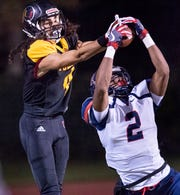 San Joaquin Memorial's Joshua Kelly (2) breaks up a pass intended for Tulare Union's Darius Baker runs into  during a CIF State Northern California Division 2-A Regional Bowl Game at Mathias Stadium on Saturday, December 8, 2018.