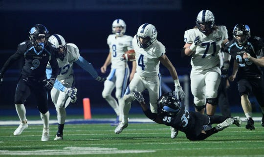 Central Valley Christian running back Jaalen Rening fights for yardage on Saturday in a CIF state championship football game in Chico.