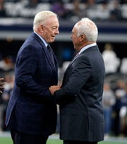 Dallas Cowboys owner Jerry Jones, left, and Philadelphia Eagles owner Jeffrey Lurie, right, before an NFL football game, in Arlington, Texas, Sunday, Dec. 9, 2018. (AP Photo/Michael Ainsworth)