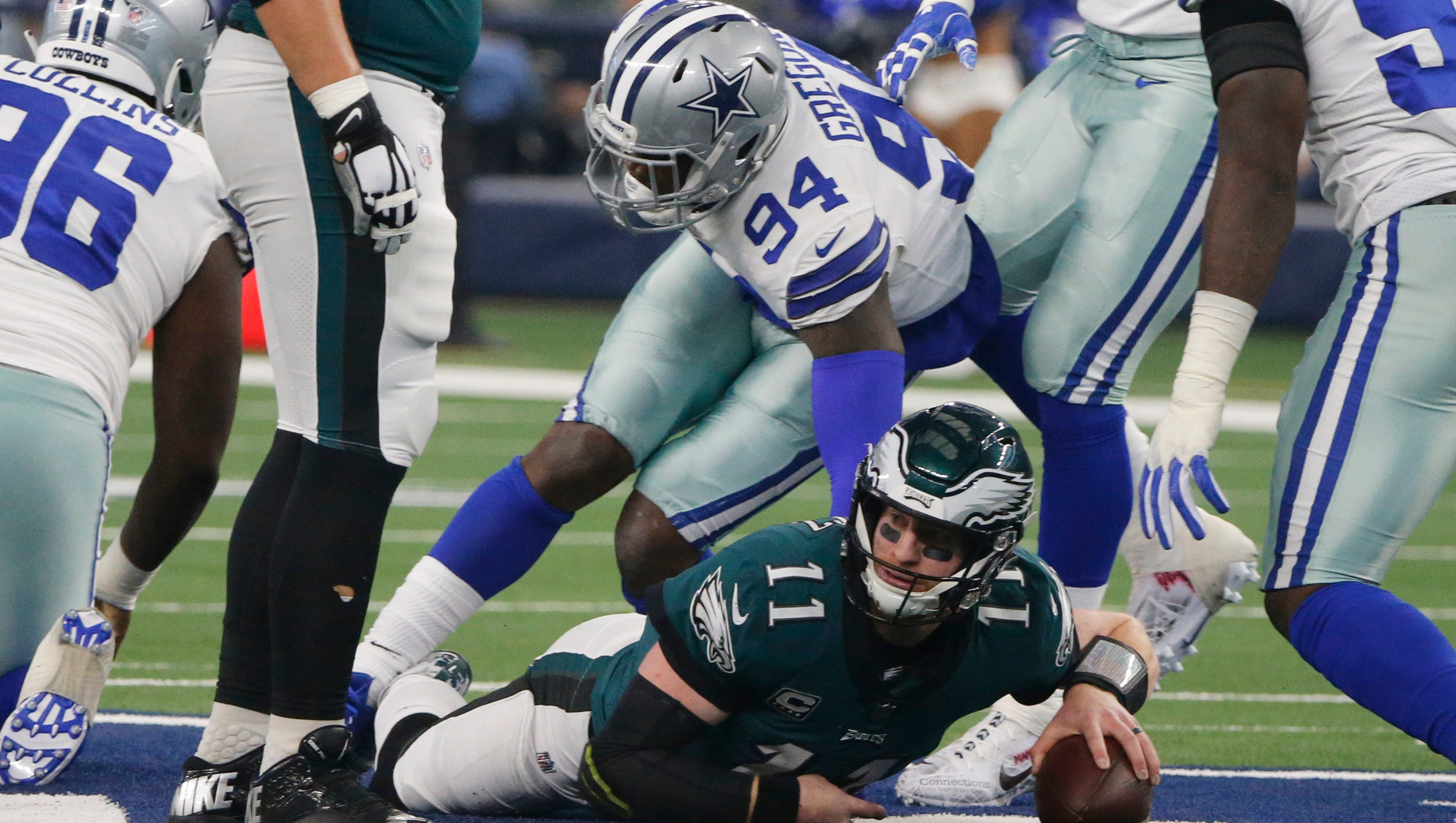 """Eagles coach Doug Pederson said Wentz's back injury """"evolved over time"""" and tests Tuesday showed the stress fracture, but his playing status is still uncertain."""