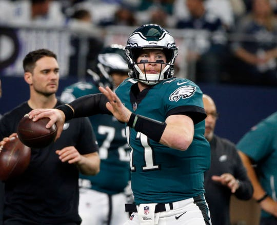 Philadelphia Eagles quarterback Carson Wentz (11) throws before an NFL football game against the Dallas Cowboys, in Arlington, Texas, Sunday, Dec. 9, 2018. (AP Photo/Michael Ainsworth)