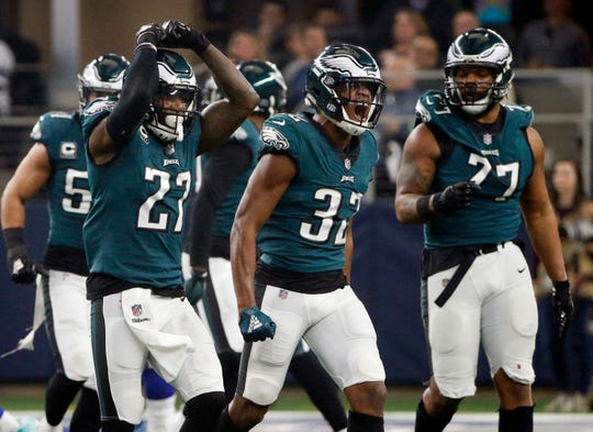 Philadelphia Eagles cornerback Rasul Douglas (32) celebrates after he intercepted a pass by Dallas Cowboys quarterback Dak Prescott during the first half of an NFL football game, in Arlington, Texas, Sunday, Dec. 9, 2018. (AP Photo/Michael Ainsworth)