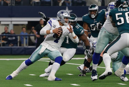 Dallas Cowboys quarterback Dak Prescott (4) is pressured by Philadelphia Eagles defensive tackle Fletcher Cox (91) during the first half of an NFL football game, in Arlington, Texas, Sunday, Dec. 9, 2018. (AP Photo/Michael Ainsworth)