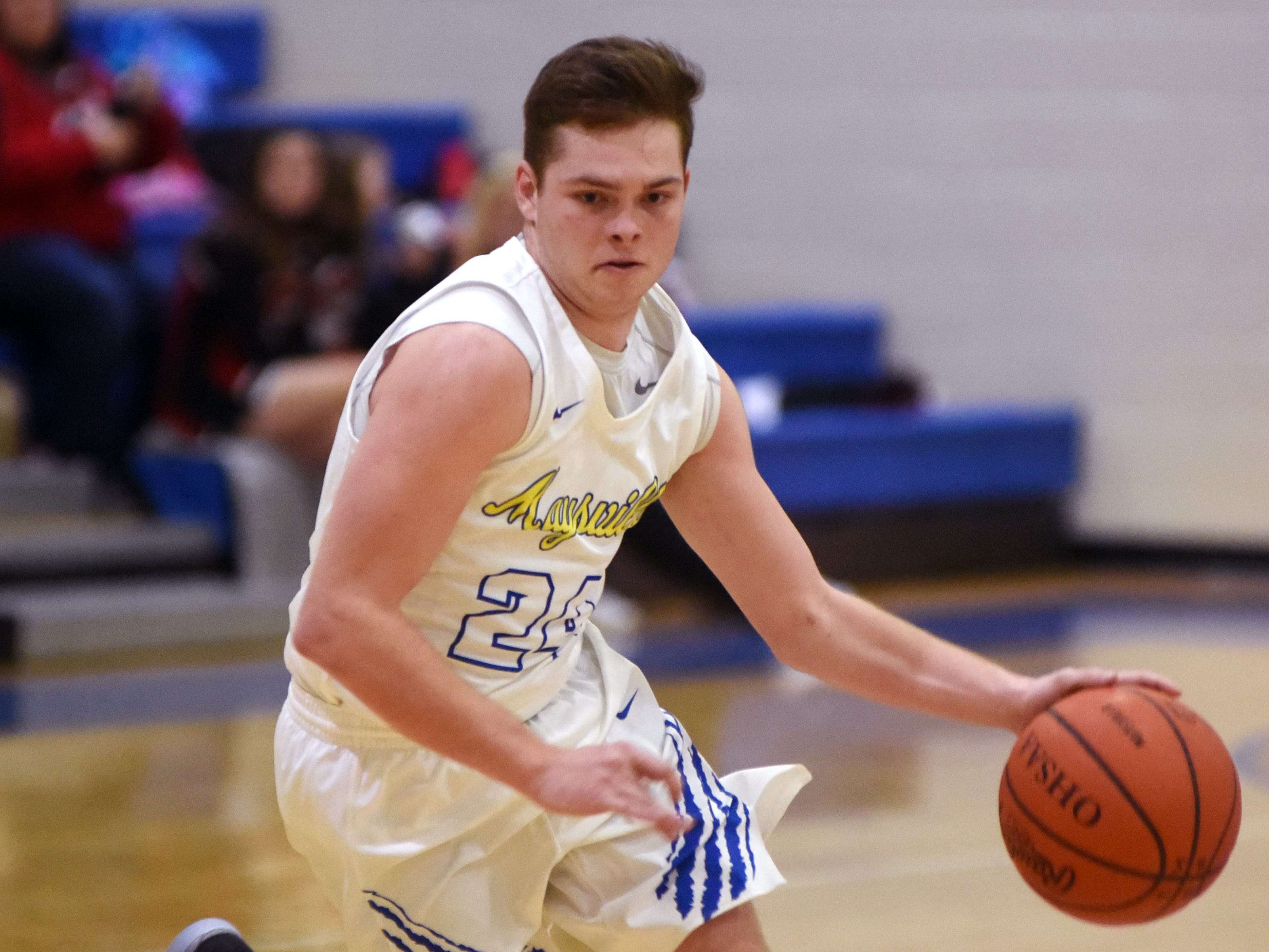 Kaiden Kerby looks for driving room during Maysville's game against Coshocton on Saturday night in Newton Township.