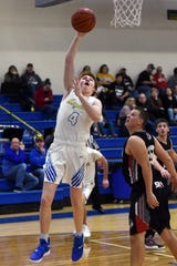 Maysville's Kyle Lake scores in the lane against Coshocton during the Panthers' 49-45 loss on Saturday night in Newton Township. Lake scored a career-high 18 points to help erase a 13-point fourth-quarter deficit.