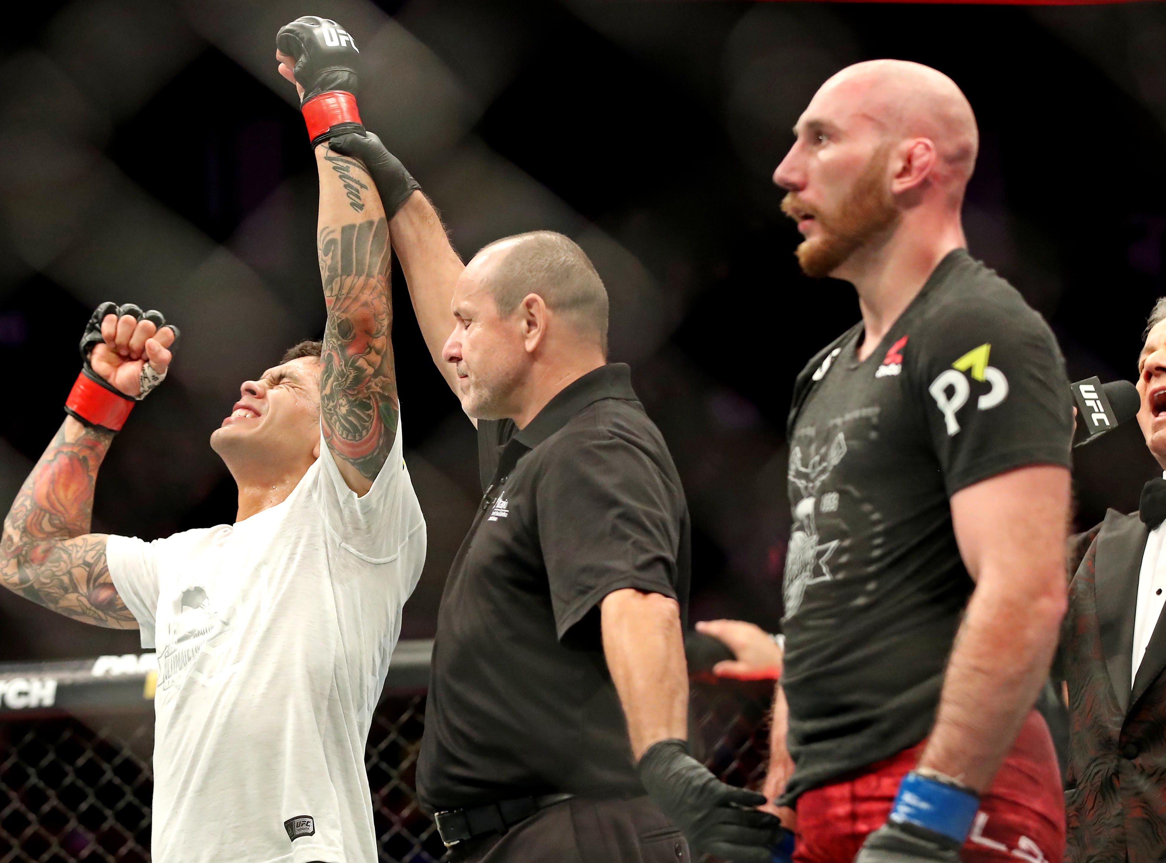 Diego Ferreira (red gloves) celebrates beating Kyle Nelson (blue gloves) during UFC 231 at Scotiabank Arena.