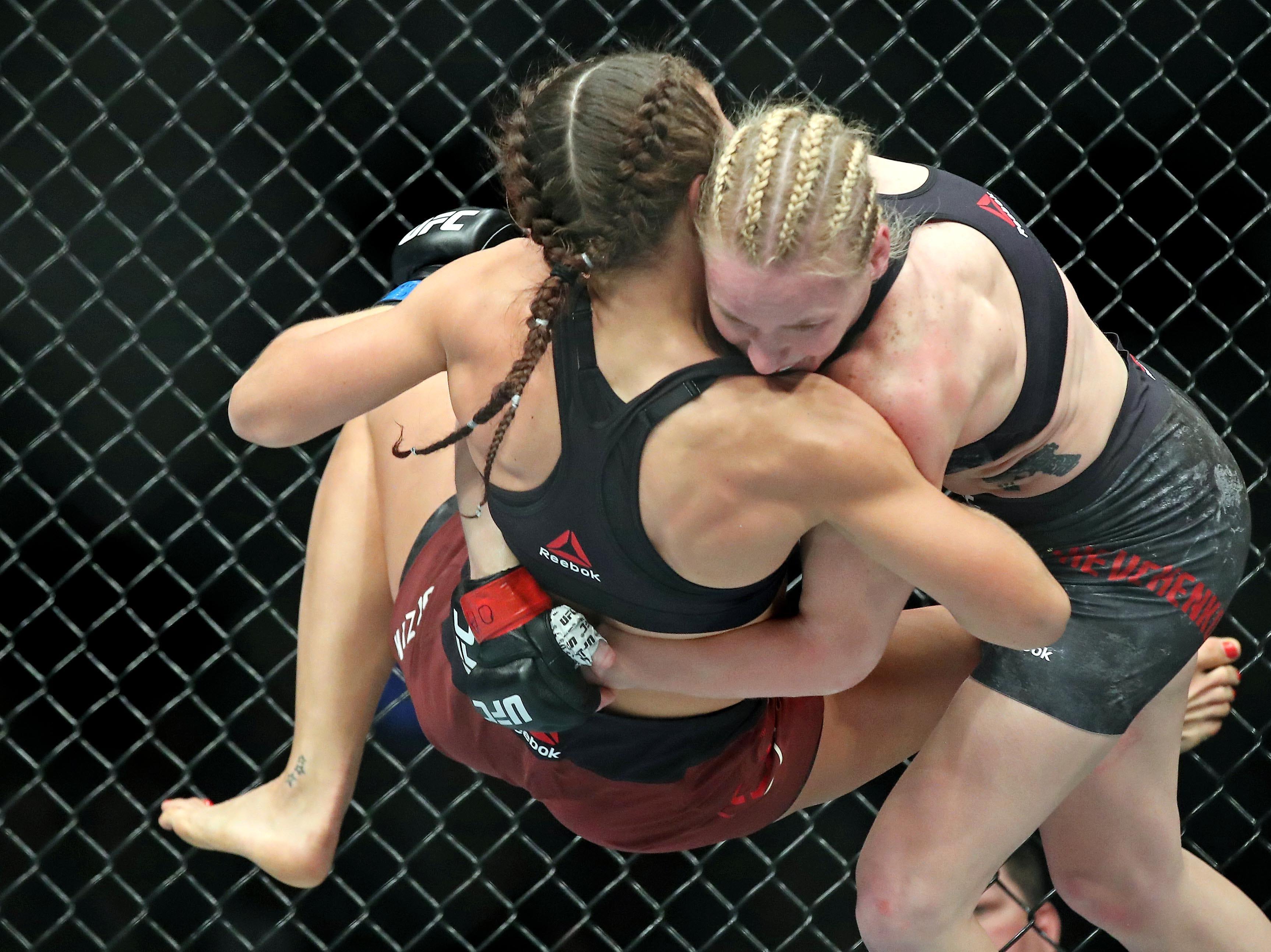 Valentina Shevchenko (red gloves) fights Joanna Jedrzejczyk (blue gloves) during UFC 231 at Scotiabank Arena.