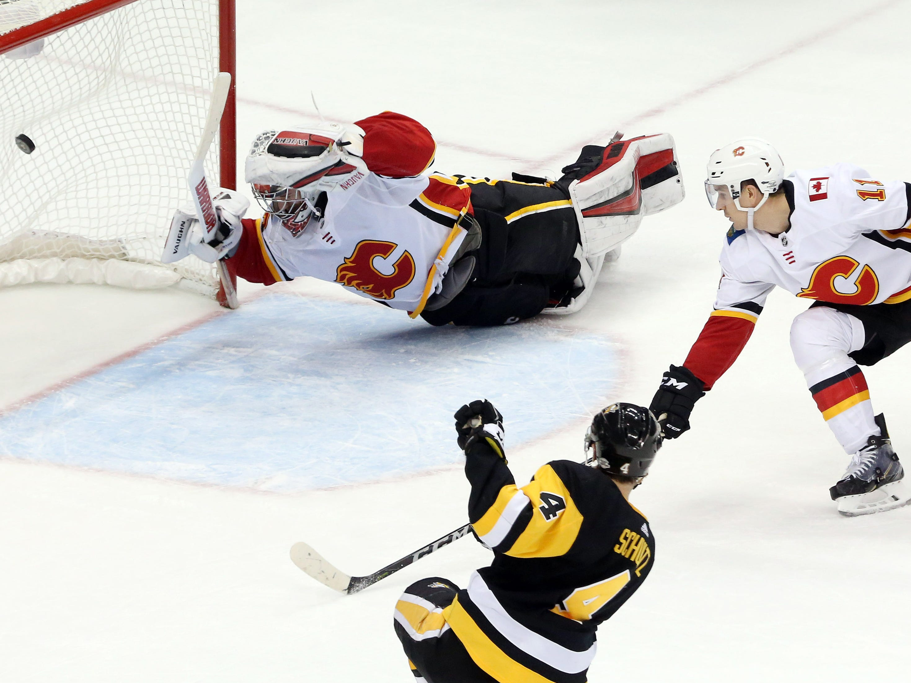 March 5: Pittsburgh Penguins defenseman Justin Schultz (4) scores the game-winning goal past Calgary Flames goaltender Jon Gillies (32) in overtime at PPG PAINTS Arena.