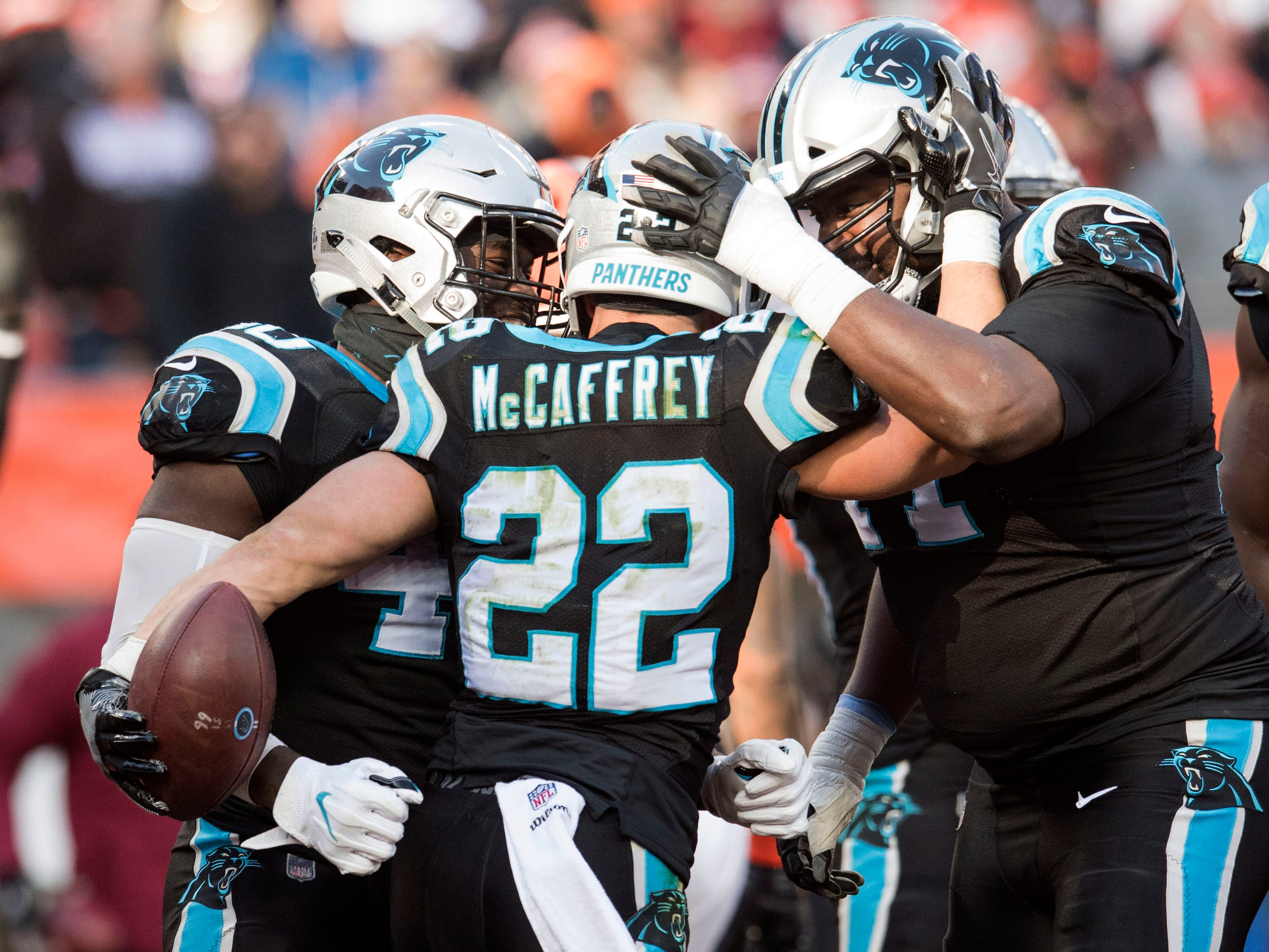 Panthers running back Christian McCaffrey celebrates after scoring a touchdown during the first quarter against the Browns.