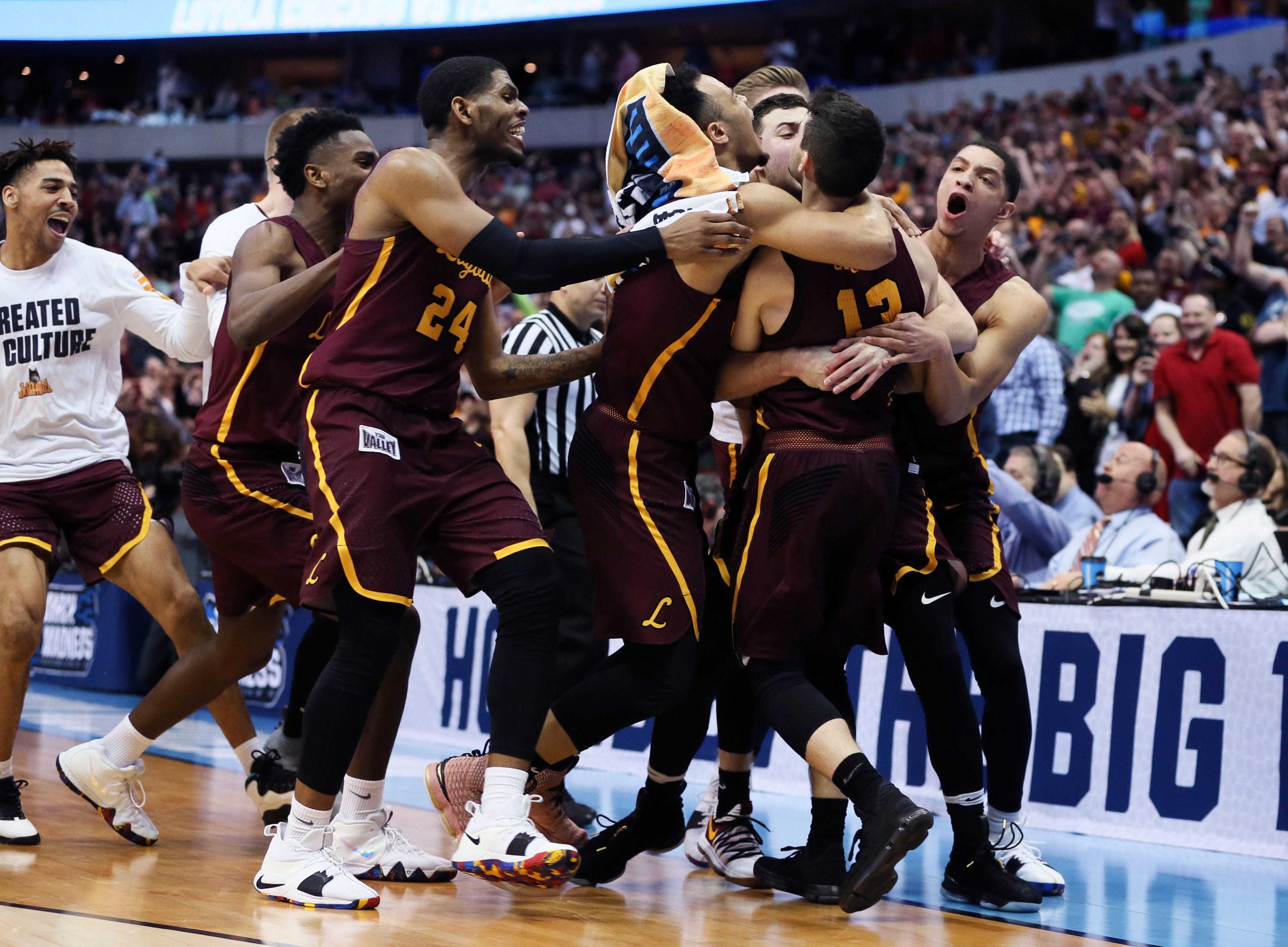March 17: Loyola-Chicago guard Clayton Custer (13) celebrates with teammates after hitting the game-winning shot to defeat the Tennessee Volunteers in the second round of the NCAA tournament.