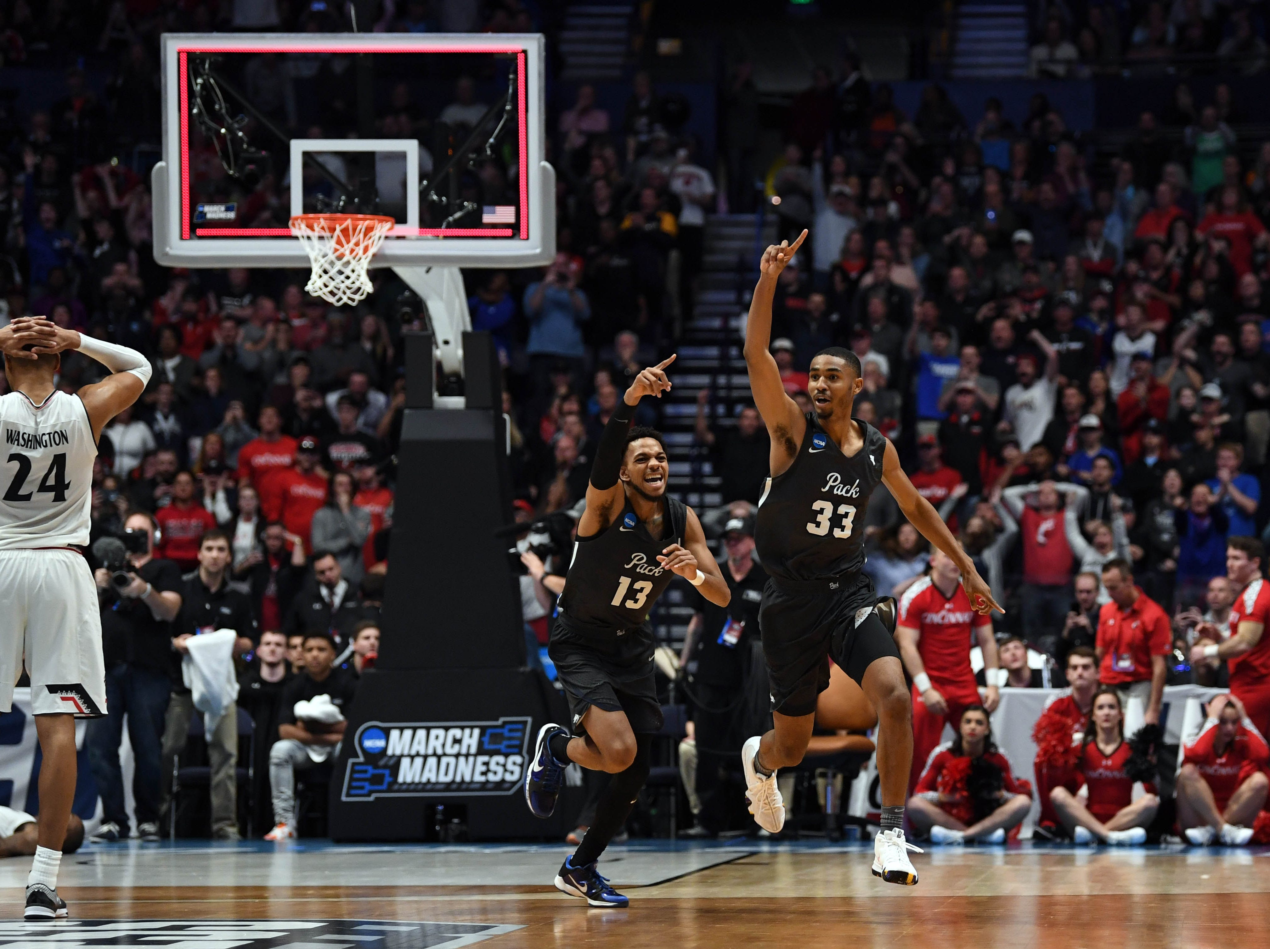 March 18: Nevada Wolf Pack guard Josh Hall (33) reacts after defeating the Cincinnati Bearcats via a big comeback in the second round of the NCAA tournament.