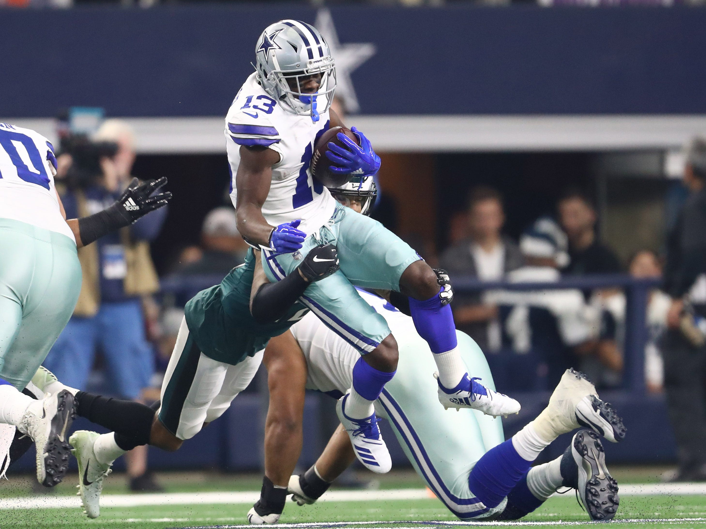 Cowboys receiver Michael Gallup runs after a reception against the Eagles.