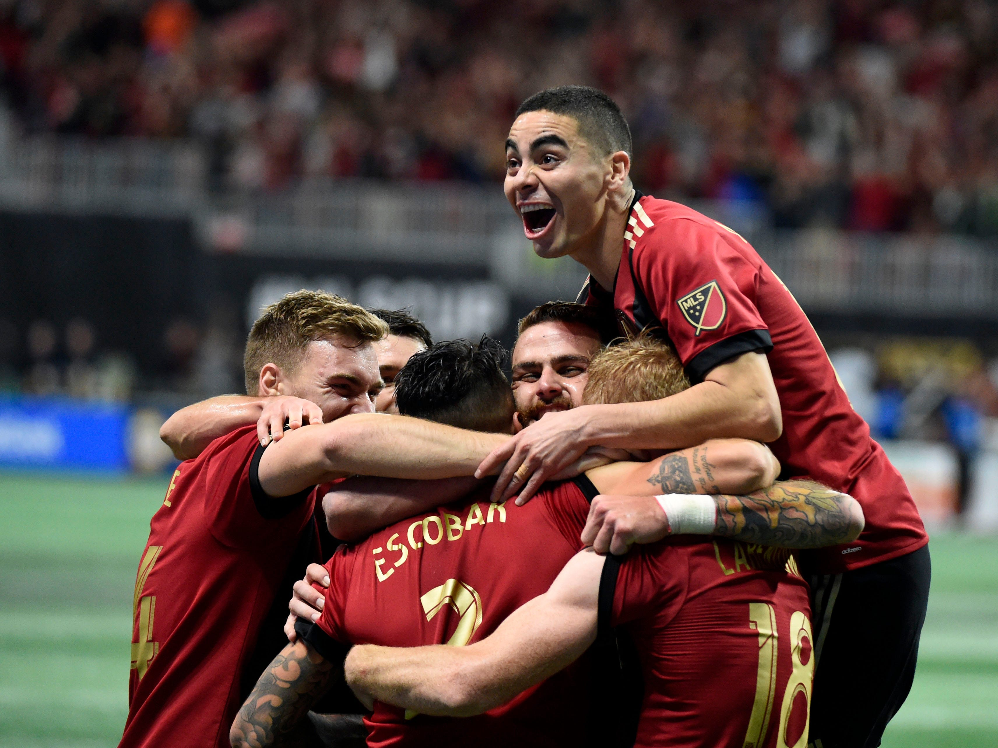 Atlanta United teammates celebrate Franco Escobar's second-half goal in the 2018 MLS Cup at Mercedes-Benz Stadium.