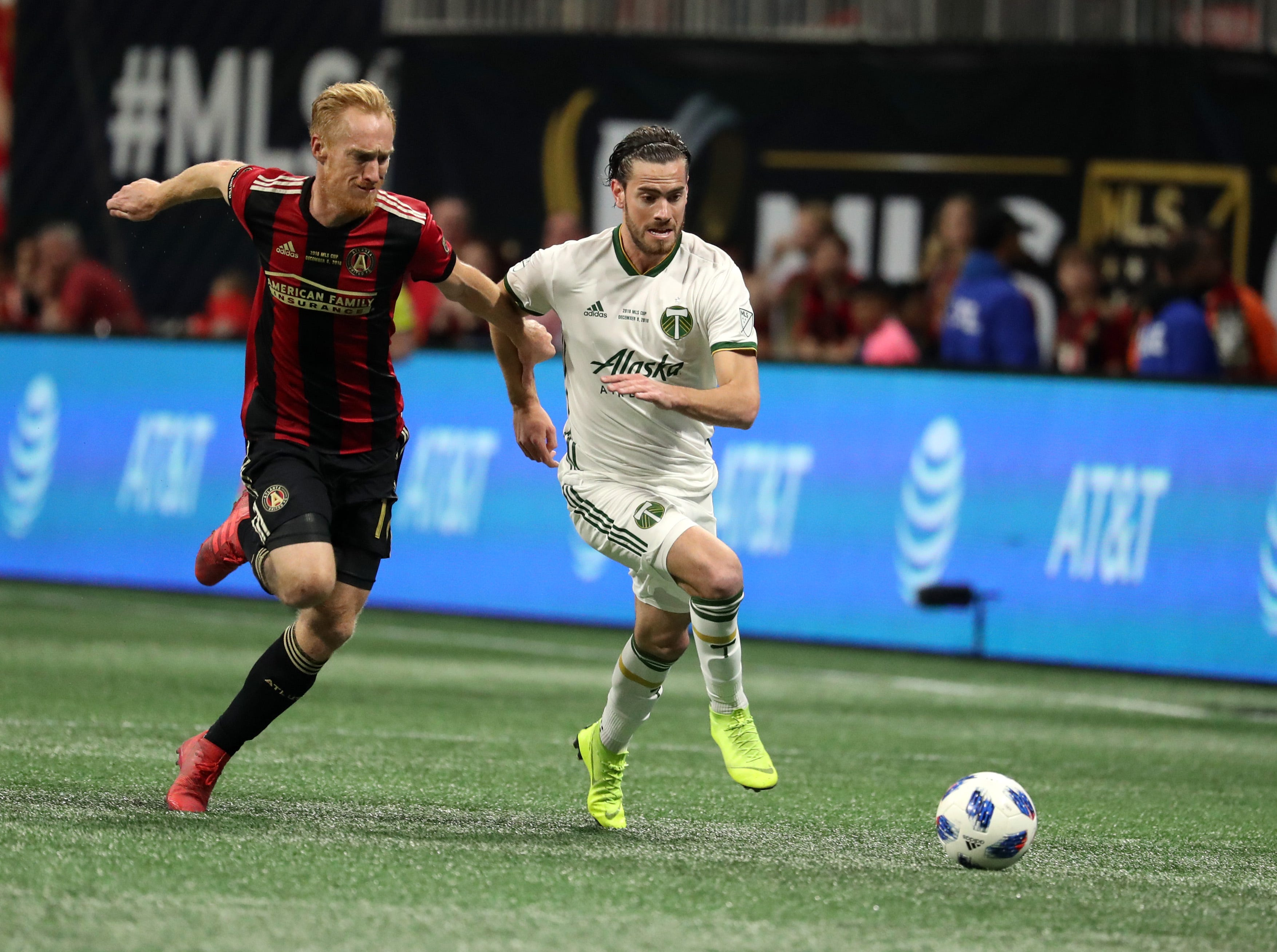 Portland Timbers forward Lucas Melano (26) outruns Atlanta United defender Jeff Larentowicz for the ball during the second half in the 2018 MLS Cup.