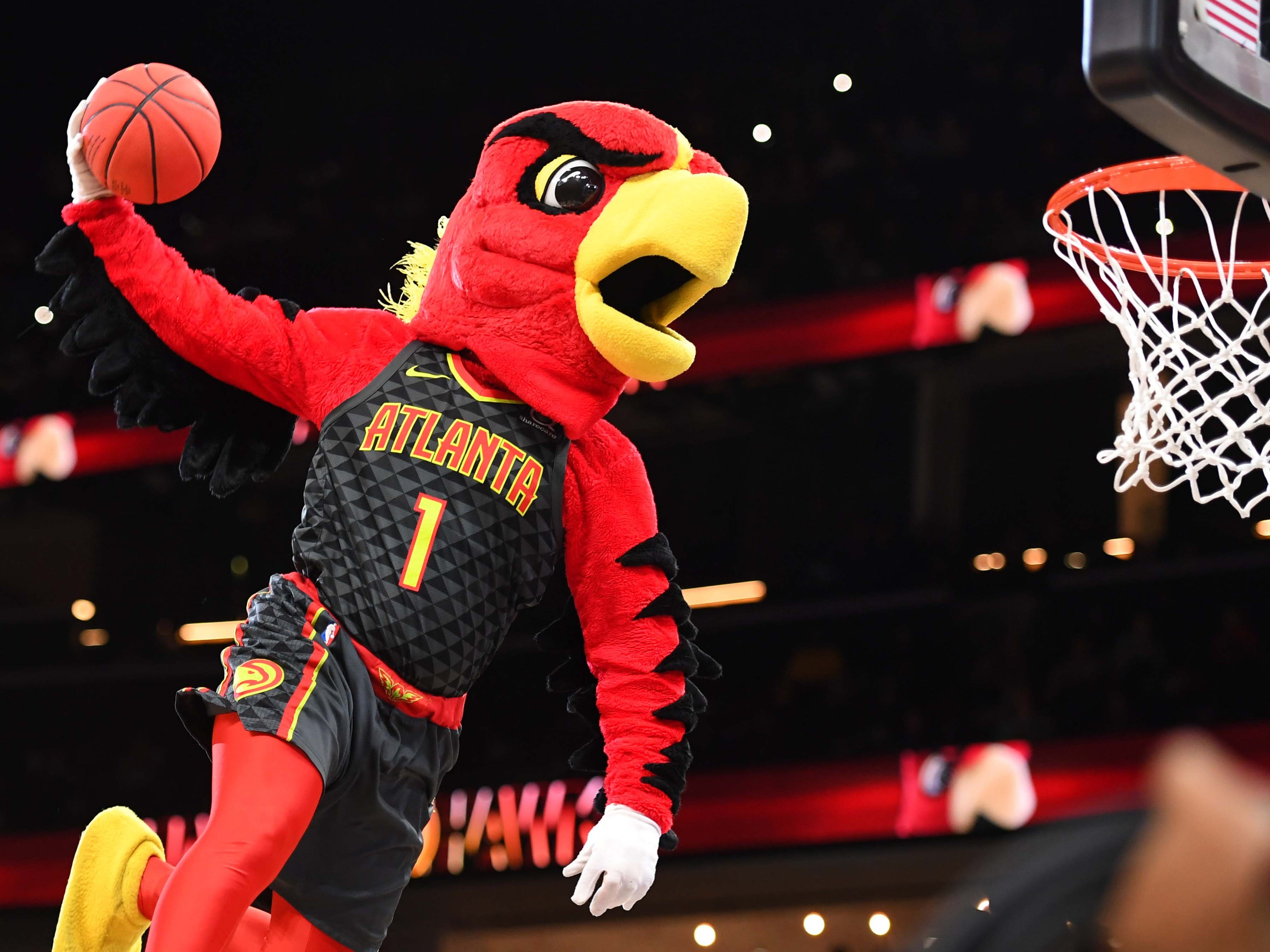Dec. 8: Atlanta mascot Harry the Hawks throws down a soaring dunk during a stop in play against the Nuggets.