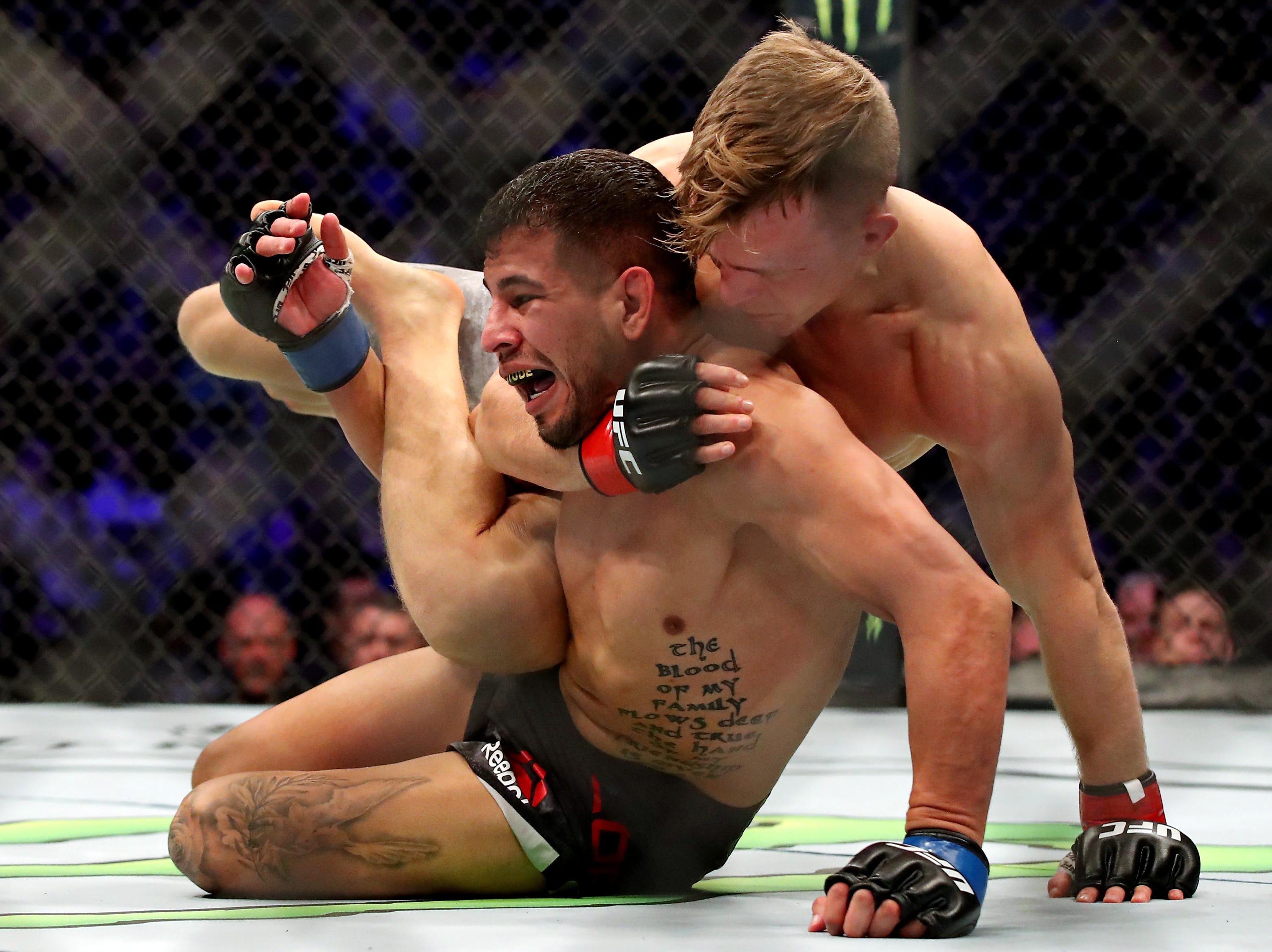 Brad Katona (red gloves) fights Matthew Lopez (blue gloves) during UFC 231 at Scotiabank Arena.