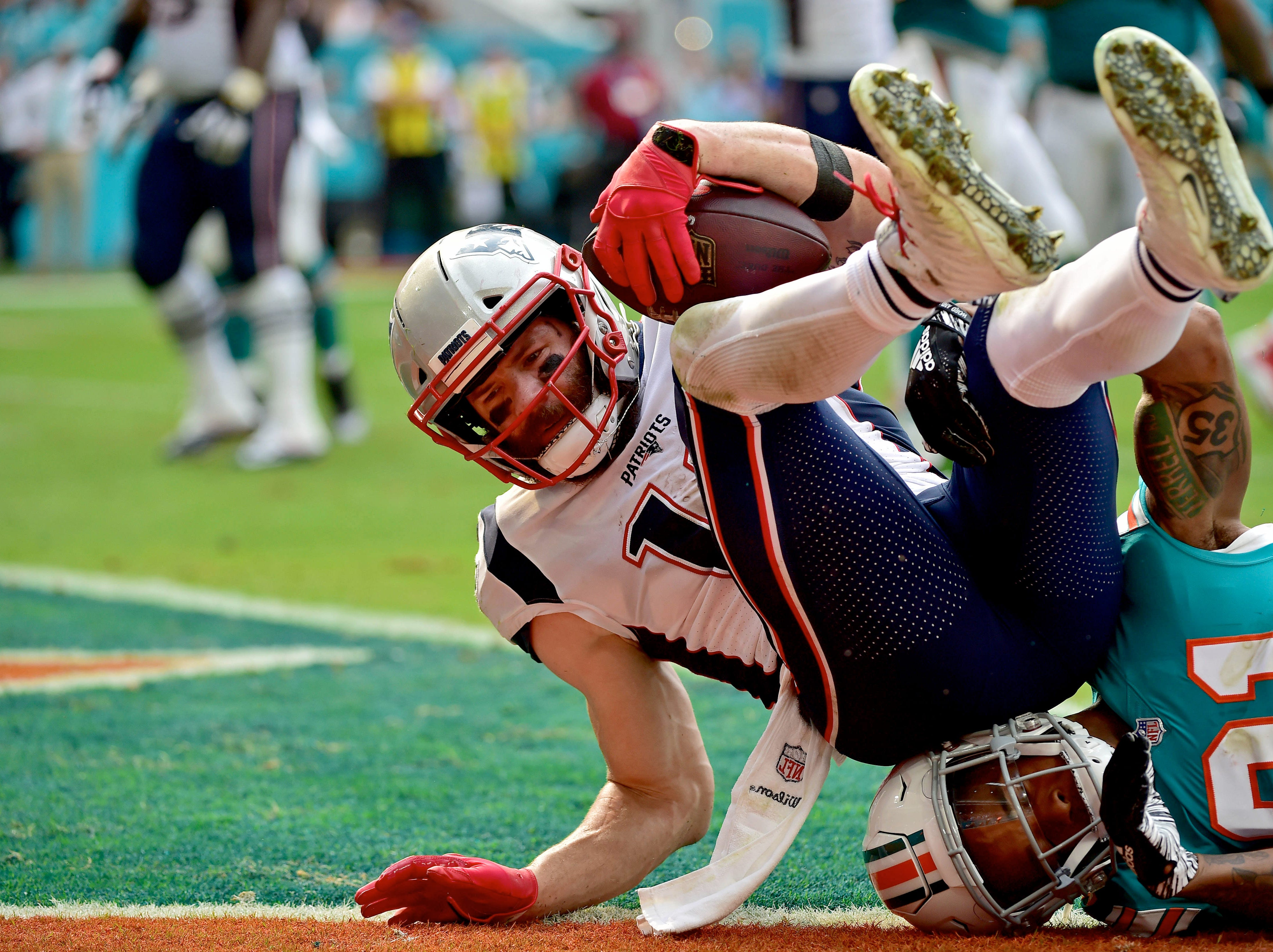 Patriots wide receiver Julian Edelman scores a touchdown against the Dolphins in the first half.