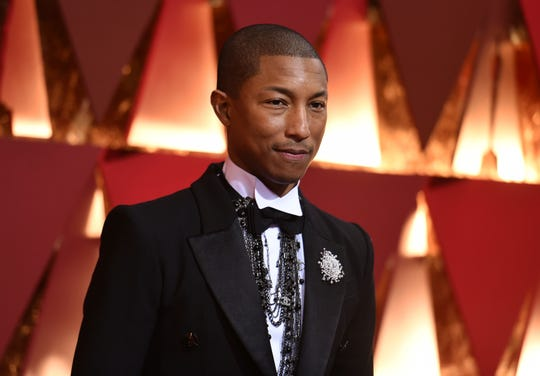 In this Feb. 26, 2017, file photo, Pharrell Williams arrives at the Oscars at the Dolby Theatre in Los Angeles. Cardi B, Pharrell, Kanye West were among the celebrities who fanned out across Miami for a week of glamorous parties toasting the world's best artists during Art Basel.