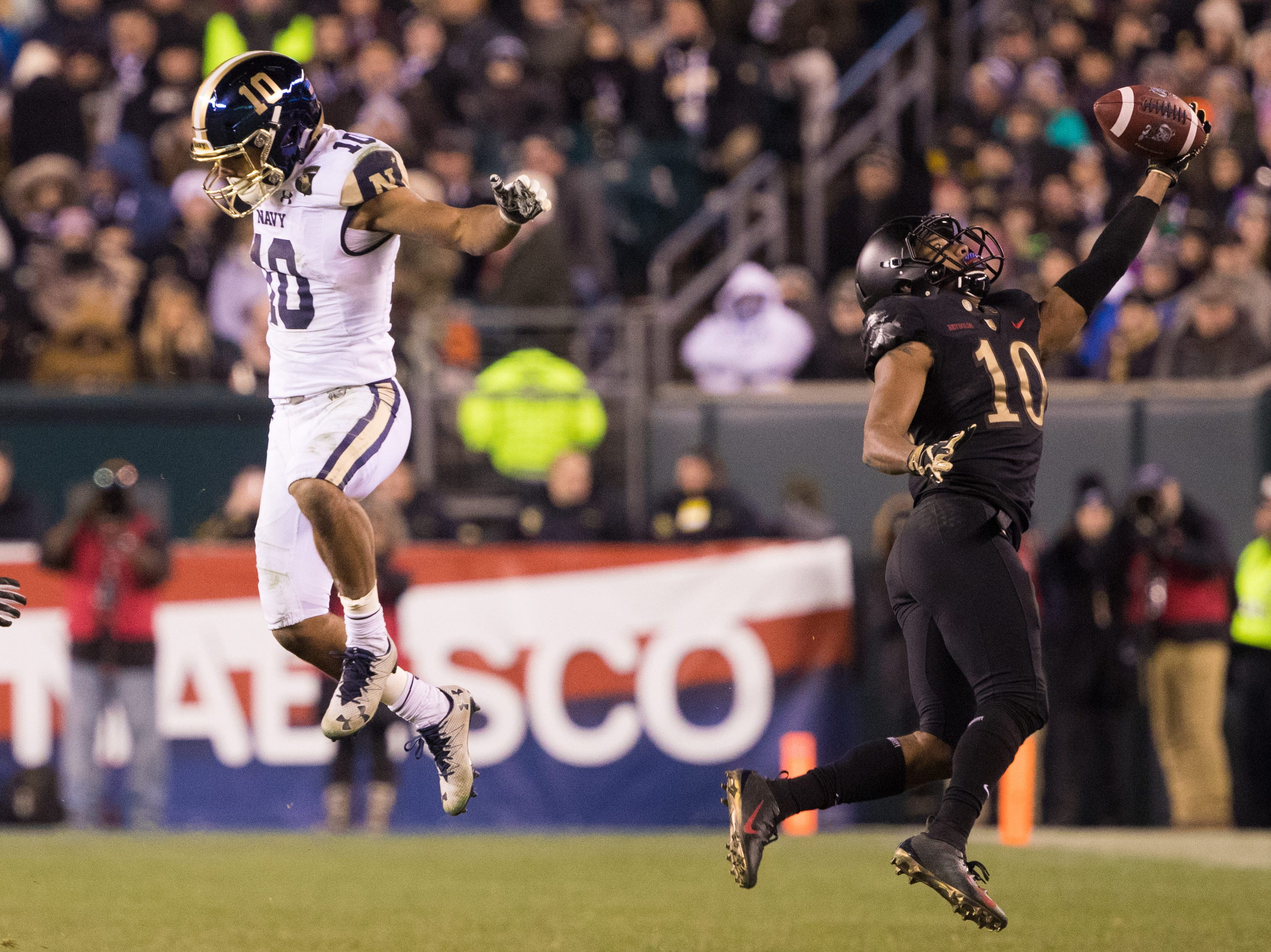 Army Black Knights defensive back Mike Reynolds (10) intercepts the ball in front of Navy Midshipmen quarterback Malcolm Perry (10) during the third quarter at Lincoln Financial Field.