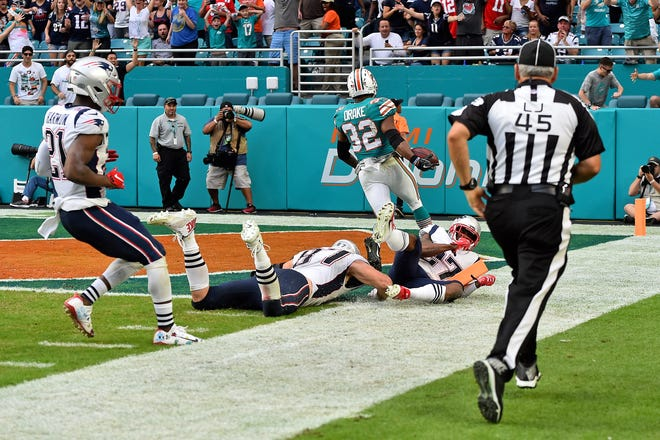 Dolphins running back Kenyan Drake leaves a string of Patriots tacklers in his wake on a game-winning touchdown with no time left.