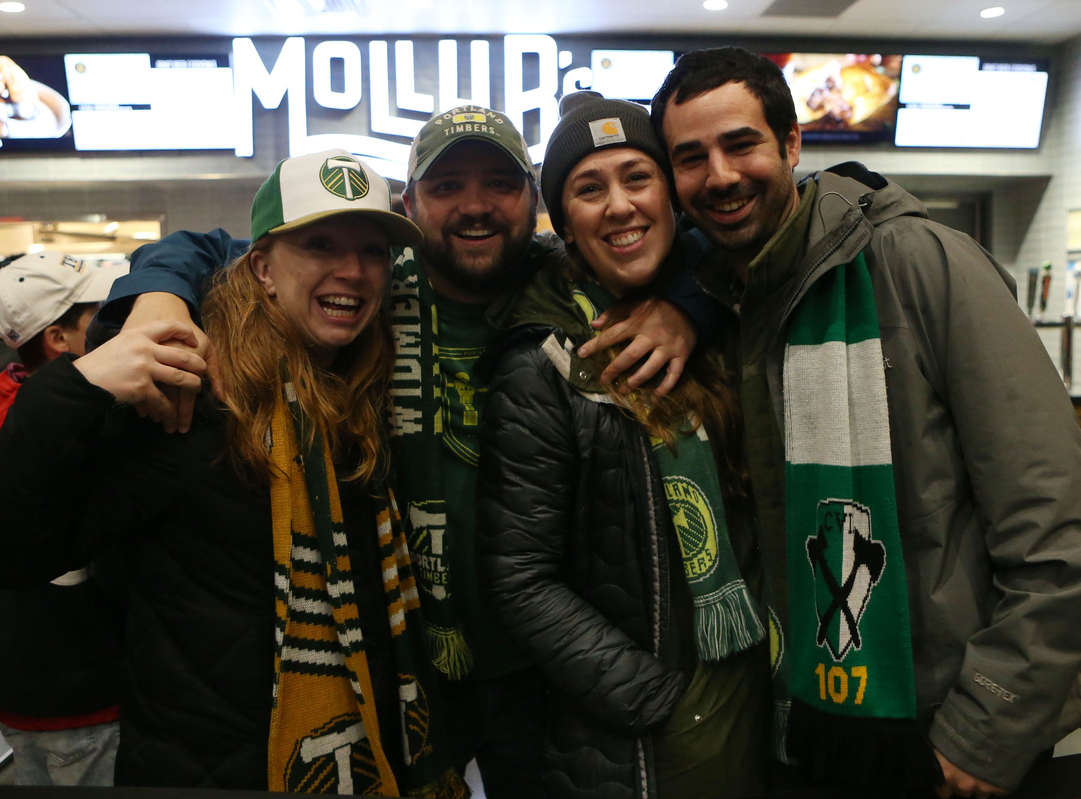 Portland fans (from left to right) Aubrey Nichols, Alex Nichols, Sam Poehlman, and Thomas Stuyvesant rock their Timbers gear prior to the 2018 MLS Cup championship game.