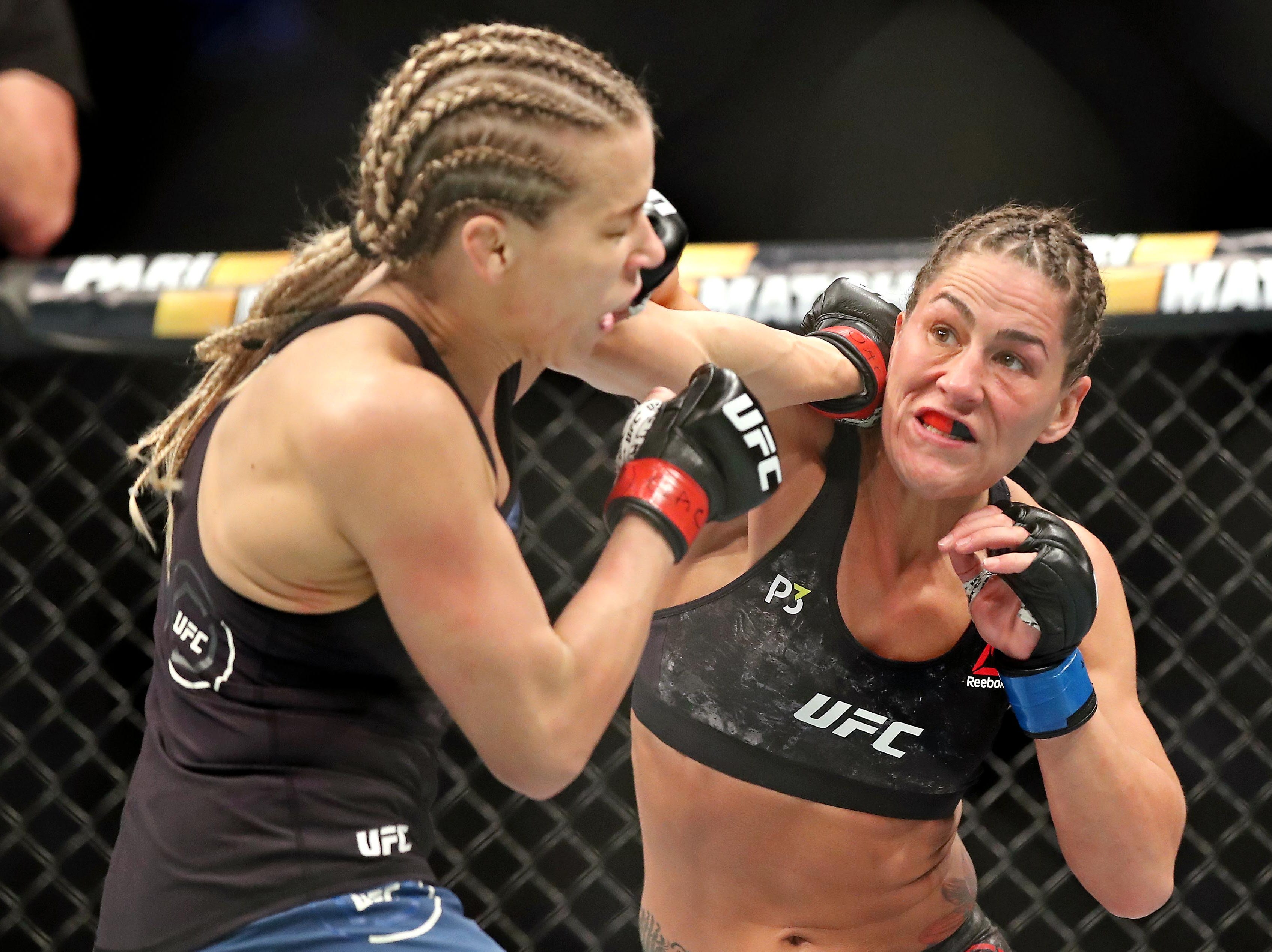 Katlyn Chookagian (red gloves) fights Jessica Eye (blue gloves) during UFC 231 at Scotiabank Arena.