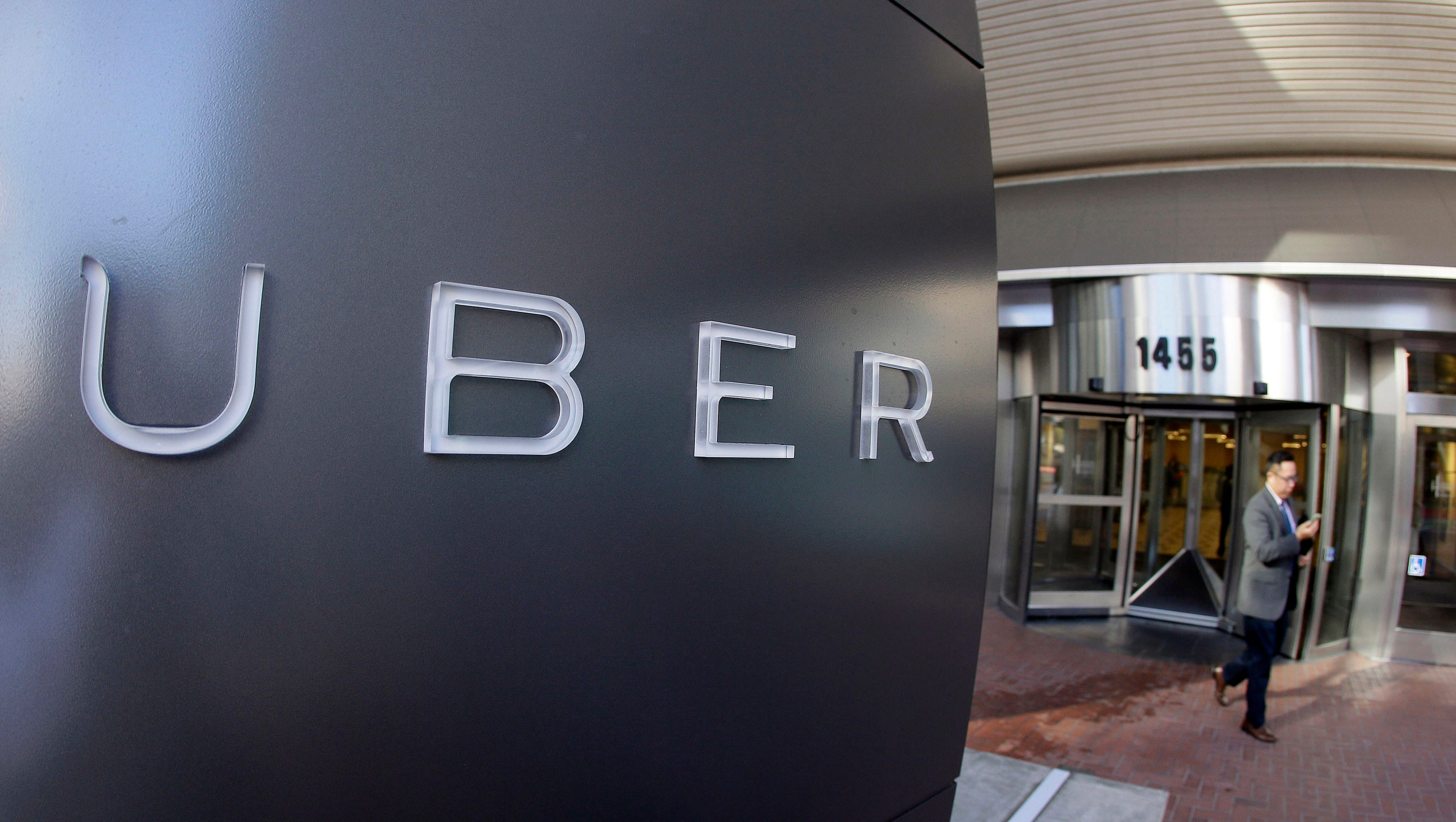 FILE - In this Dec. 16, 2014, file photo a man leaves the headquarters of Uber in San Francisco. Uber said Wednesday, June 1, 2016, that it is getting a massive cash infusion from Saudi Arabia. (AP Photo/Eric Risberg, File) ORG XMIT: NY121